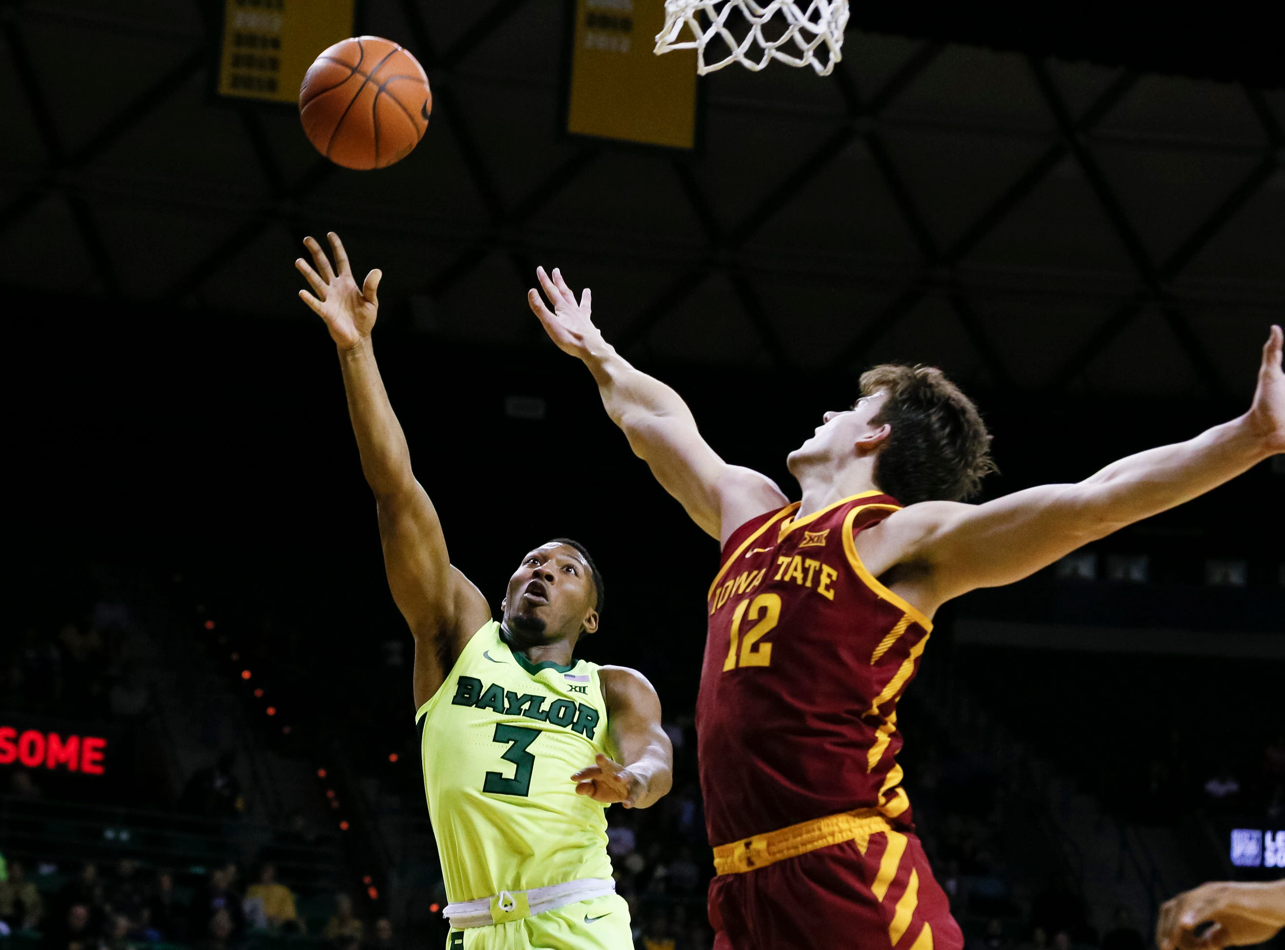 Baylor Bears guard King McClure (3) shoots over Iowa State Cyclones forward Michael Jacobson (12) during the first half at Ferrell Center.
