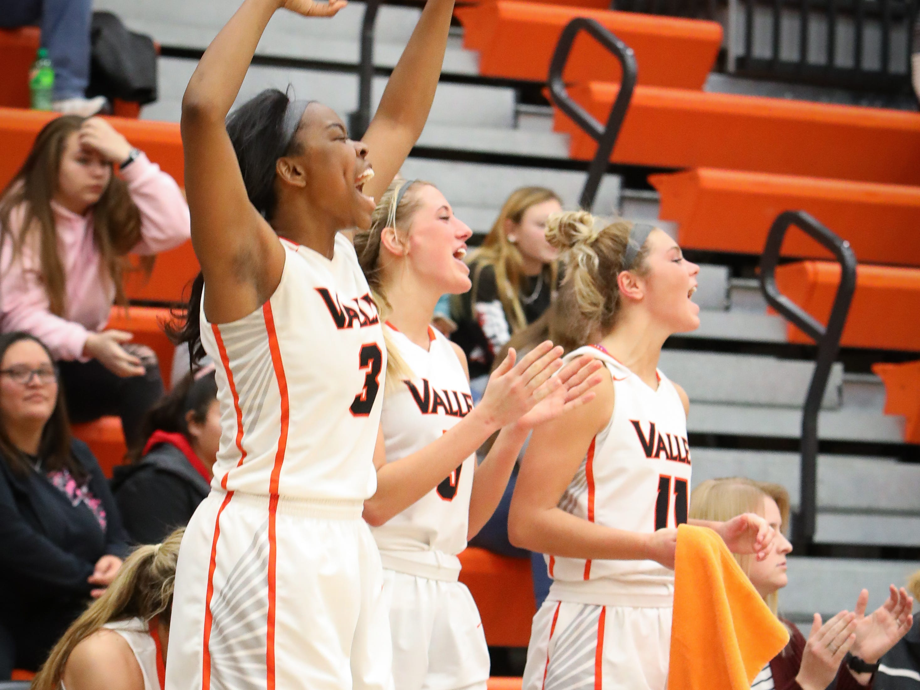 Members of the Valley bench cheer on their teammates during a girls high school basketball game between the East Scarlets and the Valley Tigers at Coldiron Fieldhouse at Valley High School on Jan. 8, 2019 in West Des Moines, Iowa.