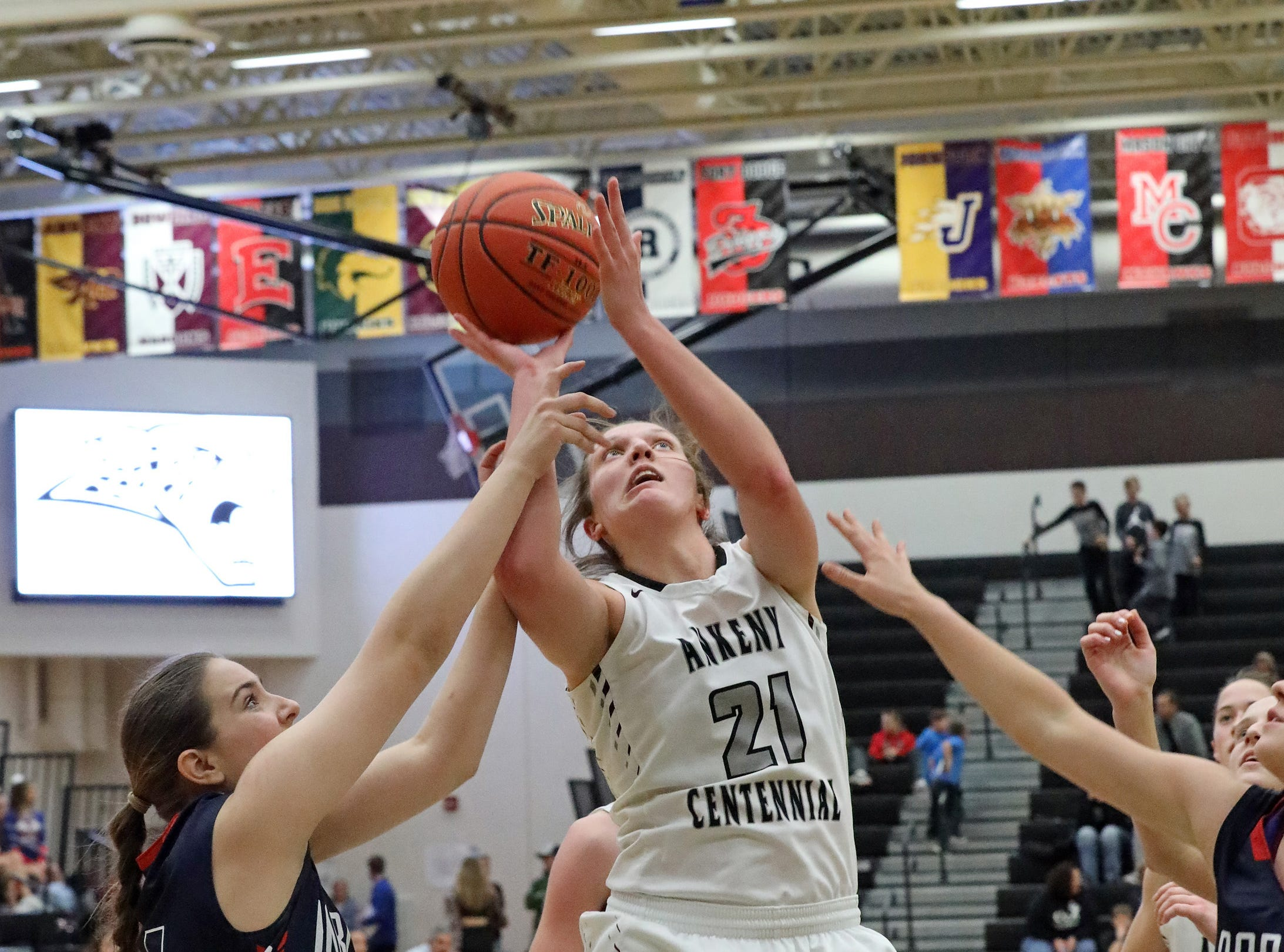 Ankeny Centennial senior Rachel Schon is fouled as she makes the shot as the Marshalltown Bobcats compete against the Ankeny Centennial Jaguars in high school girls basketball on Tuesday, Jan. 8, 2019 at Ankeny Centennial High School. ACHS won 70 to 19.