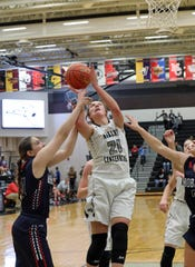 Ankeny Centennial senior Rachel Schon is fouled as she makes a shot in a Jan. 8 game against Marshalltown. Schon — Centennial's leading scorer this season — averaged 16.5 points and eight rebounds in substate wins over Sioux City East and Pleasant Valley.