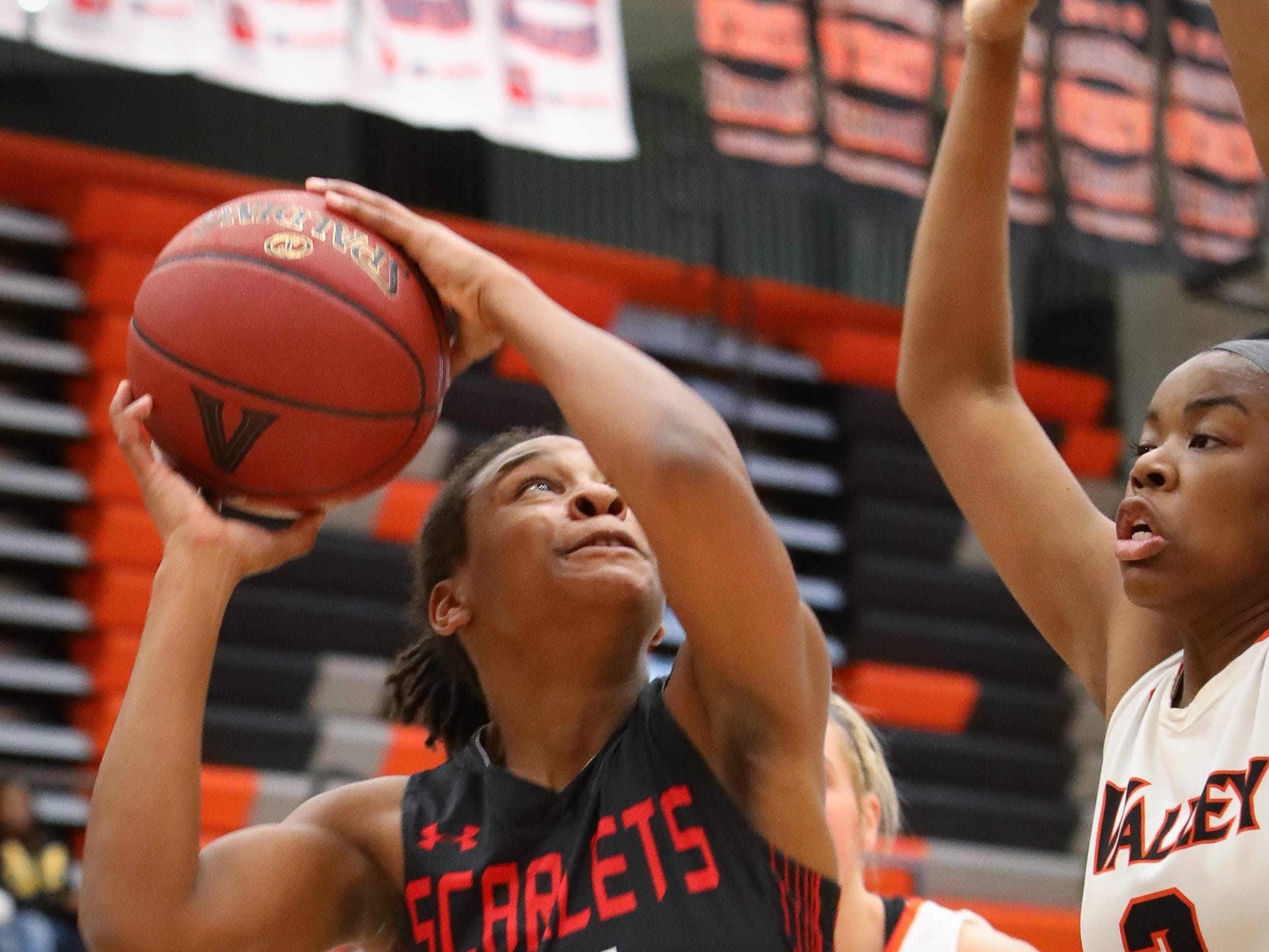 East senior Tatiana Hodges-Johnson goes for a layup during a girls high school basketball game between the East Scarlets and the Valley Tigers at Coldiron Fieldhouse at Valley High School on Jan. 8, 2019 in West Des Moines, Iowa.
