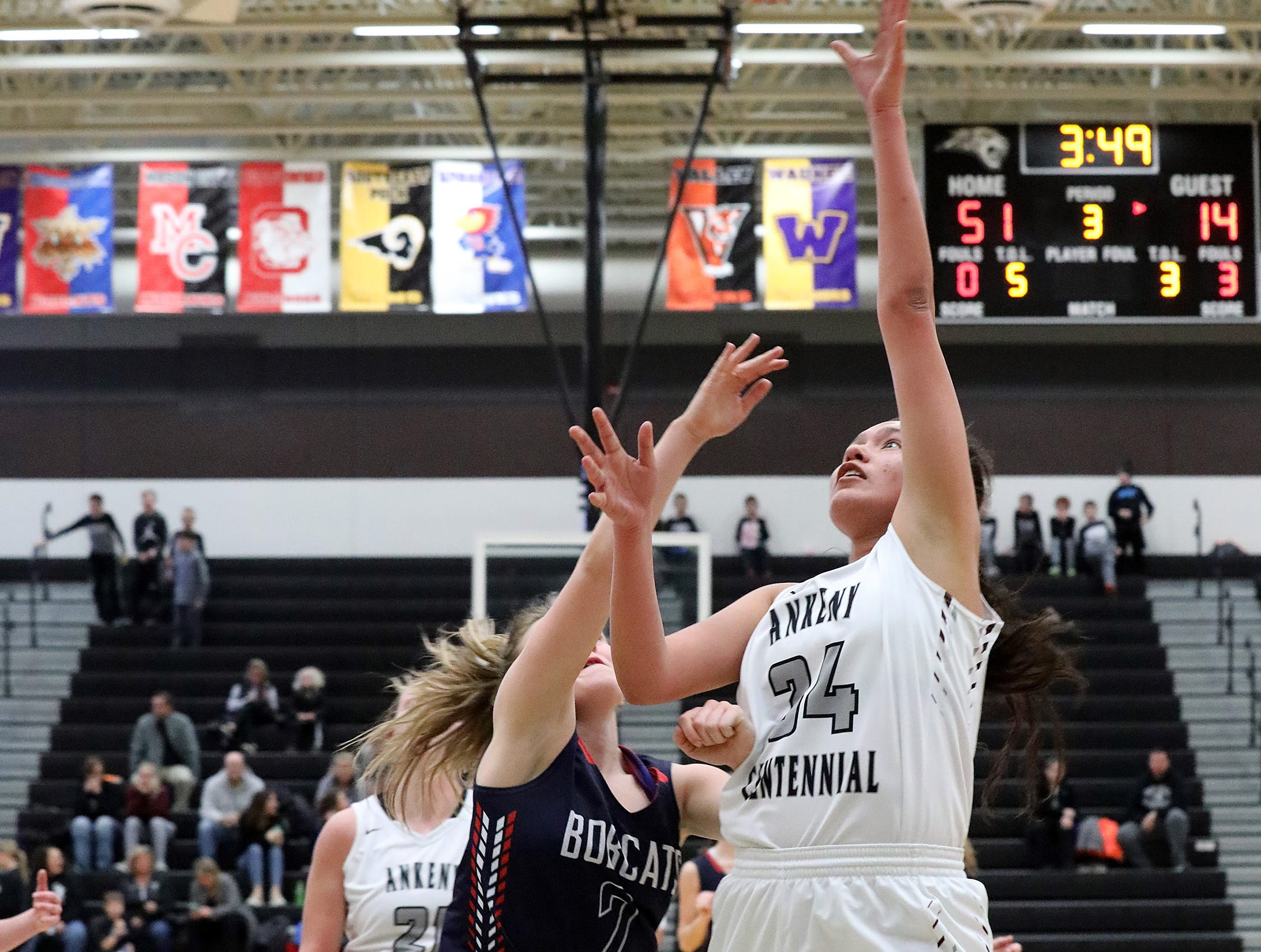 Ankeny Centennial junior Alexandria Keahna-Harris scores two points on the lay-up as the Marshalltown Bobcats compete against the Ankeny Centennial Jaguars in high school girls basketball on Tuesday, Jan. 8, 2019 at Ankeny Centennial High School.
