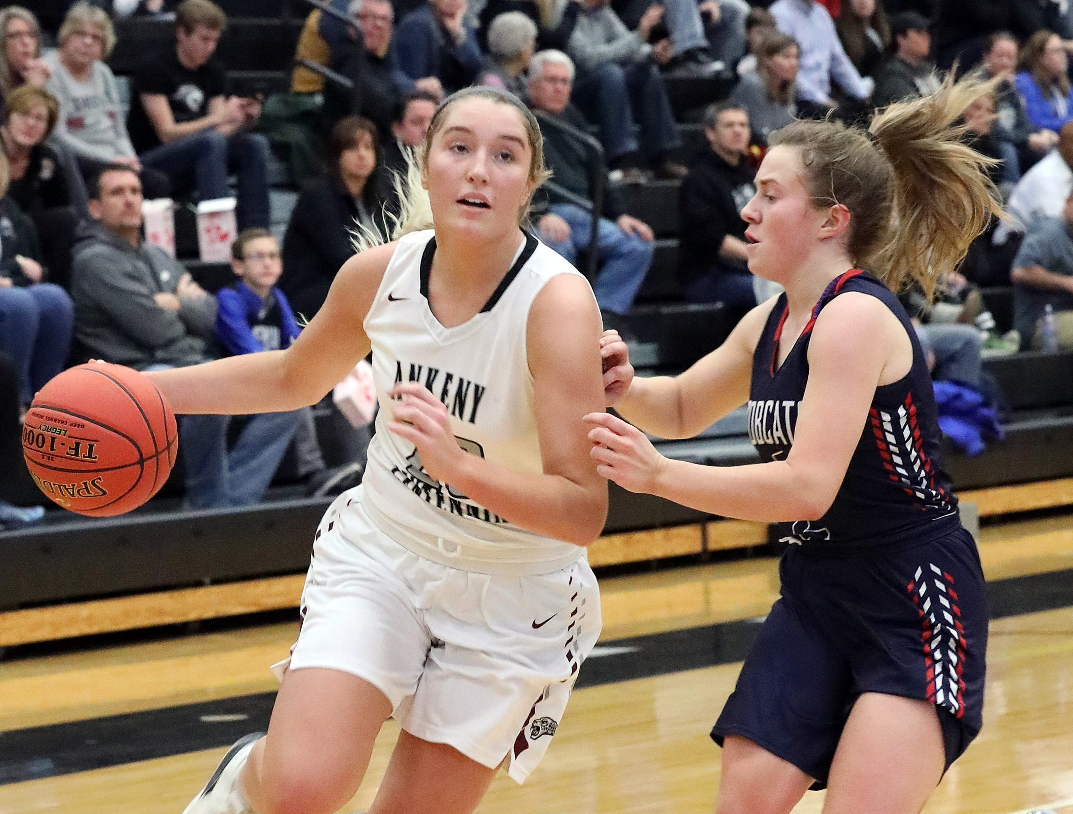 Ankeny Centennial senior Kenna Sauer drives past the defense as the Marshalltown Bobcats compete against the Ankeny Centennial Jaguars in high school girls basketball on Tuesday, Jan. 8, 2019 at Ankeny Centennial High School.