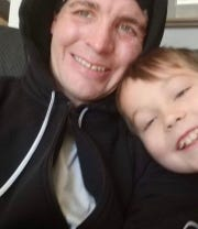 Christopher David Bagley, 31, of Walker, Iowa, with his son, Mason, in this undated photograph. Bagley has been missing since Dec. 14, 2018.