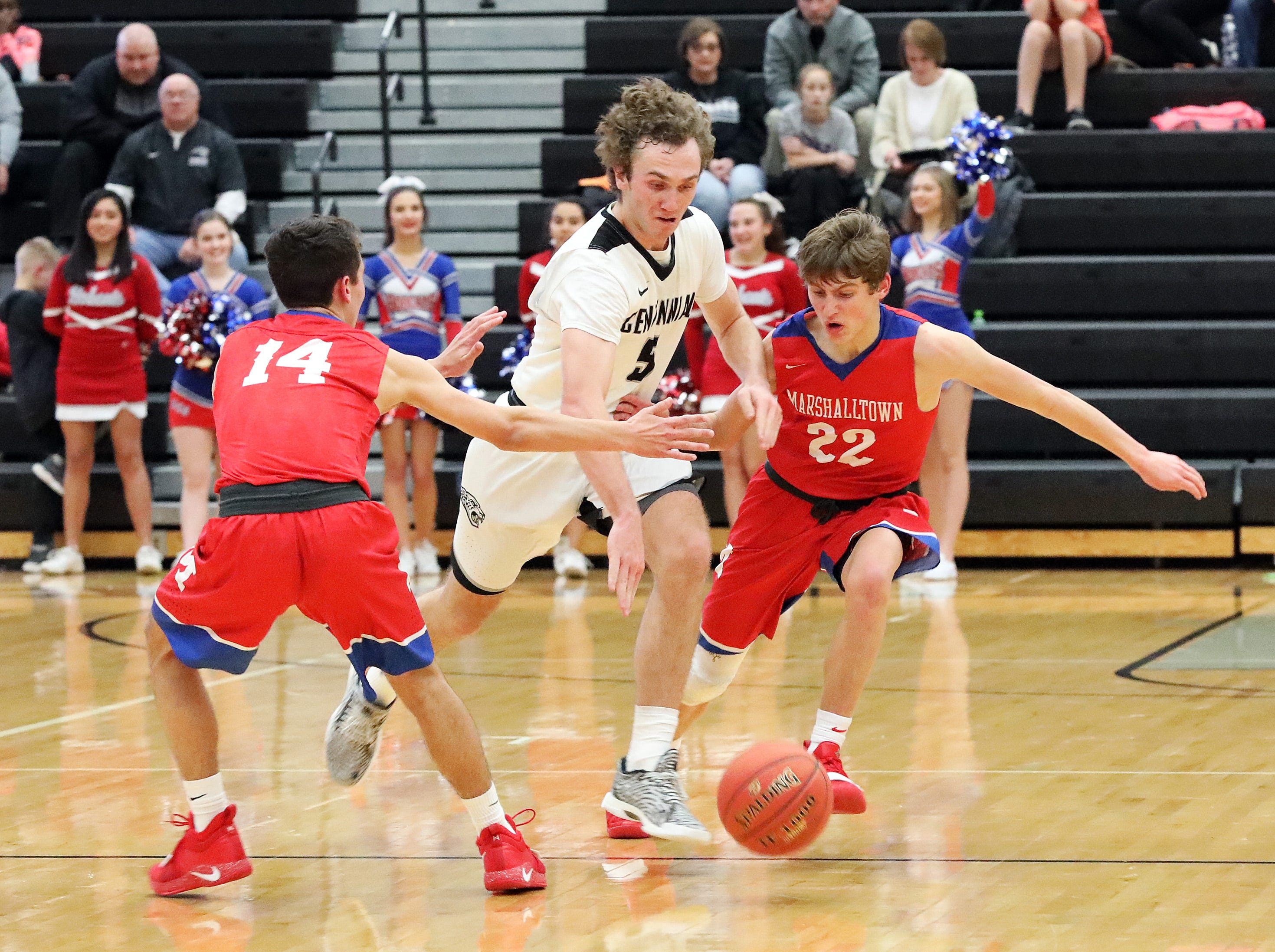 Ankeny Centennial junior Preston Kelling works through the double-team coverage as the Marshalltown Bobcats compete against the Ankeny Centennial Jaguars in high school boys basketball on Tuesday, Jan. 8, 2019 at Ankeny Centennial High.
