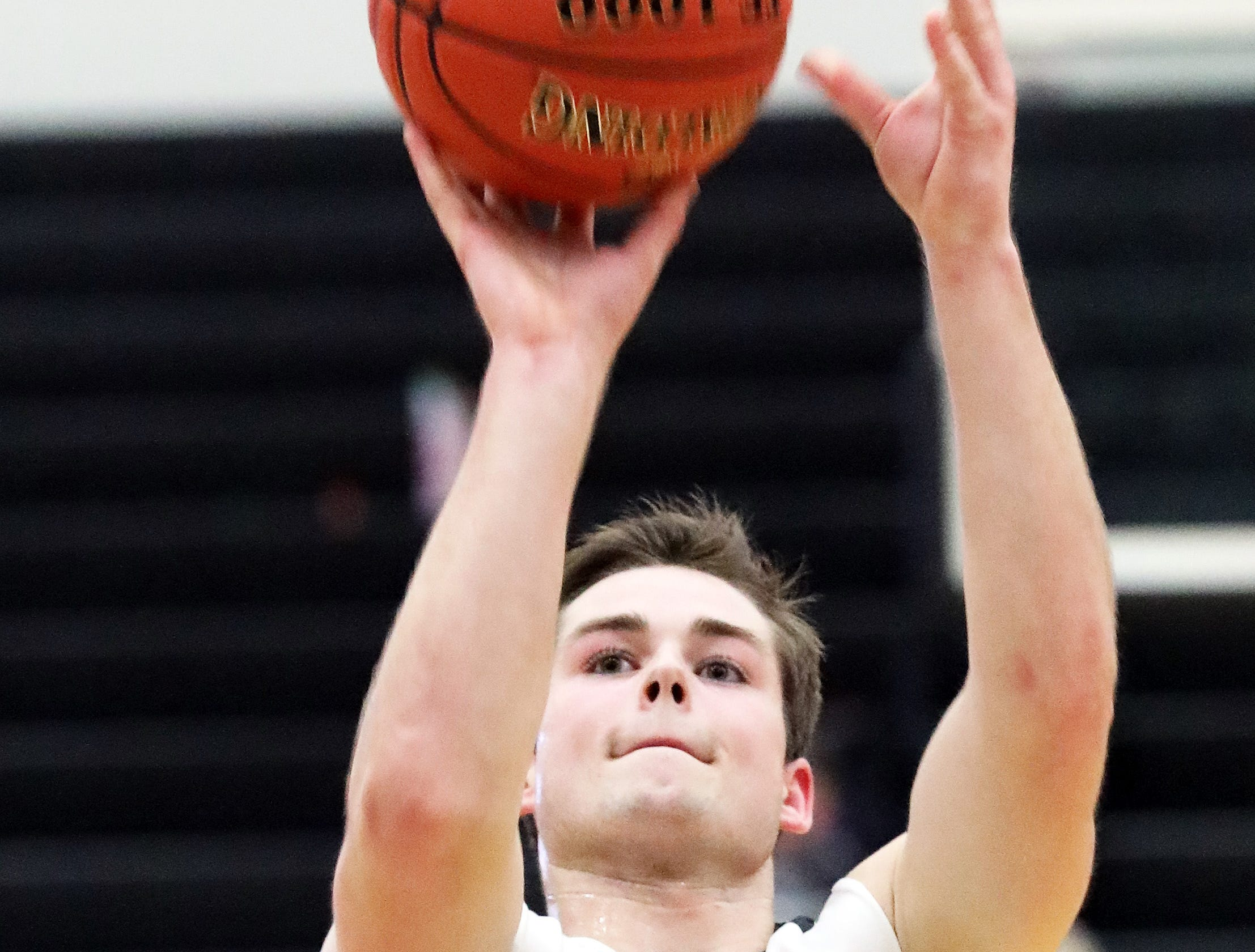 Ankeny Centennial senior Tyler Rodgers shoots a free throw as the Marshalltown Bobcats compete against the Ankeny Centennial Jaguars in high school boys basketball on Tuesday, Jan. 8, 2019 at Ankeny Centennial High.