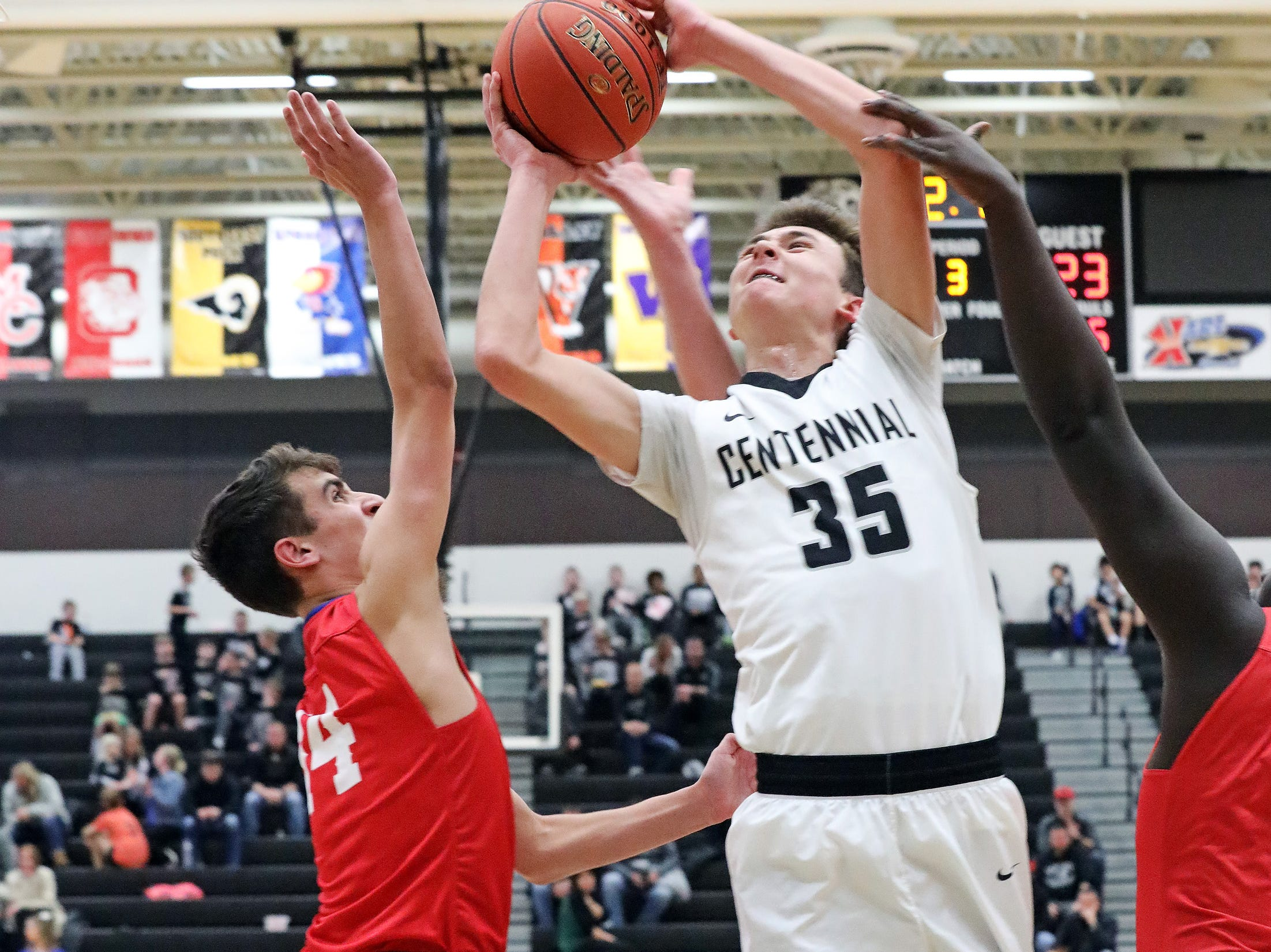 Ankeny Centennial junior Cody McCullough is fouled while shooting as the Marshalltown Bobcats compete against the Ankeny Centennial Jaguars in high school boys basketball on Tuesday, Jan. 8, 2019 at Ankeny Centennial High.