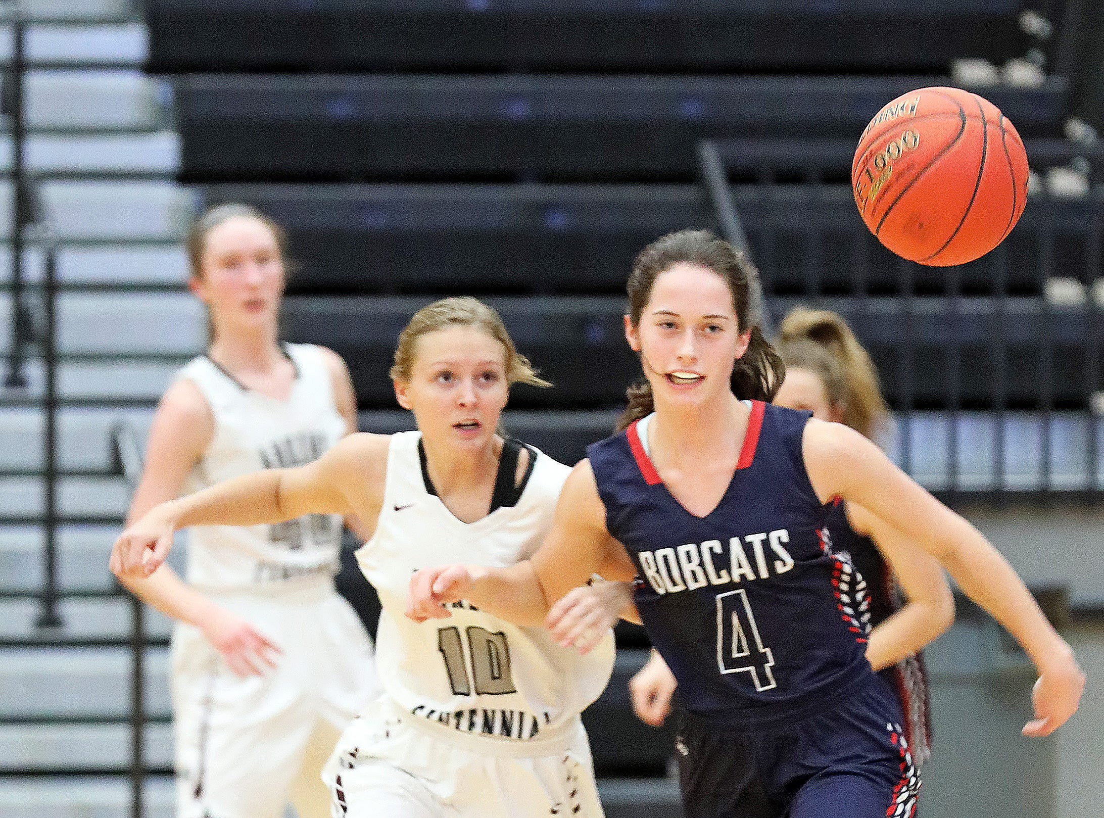Ankeny Centennial senior Lily King and Marshalltown junior Erica Johnson chase the loose ball as the Marshalltown Bobcats compete against the Ankeny Centennial Jaguars in high school girls basketball on Tuesday, Jan. 8, 2019 at Ankeny Centennial High School.