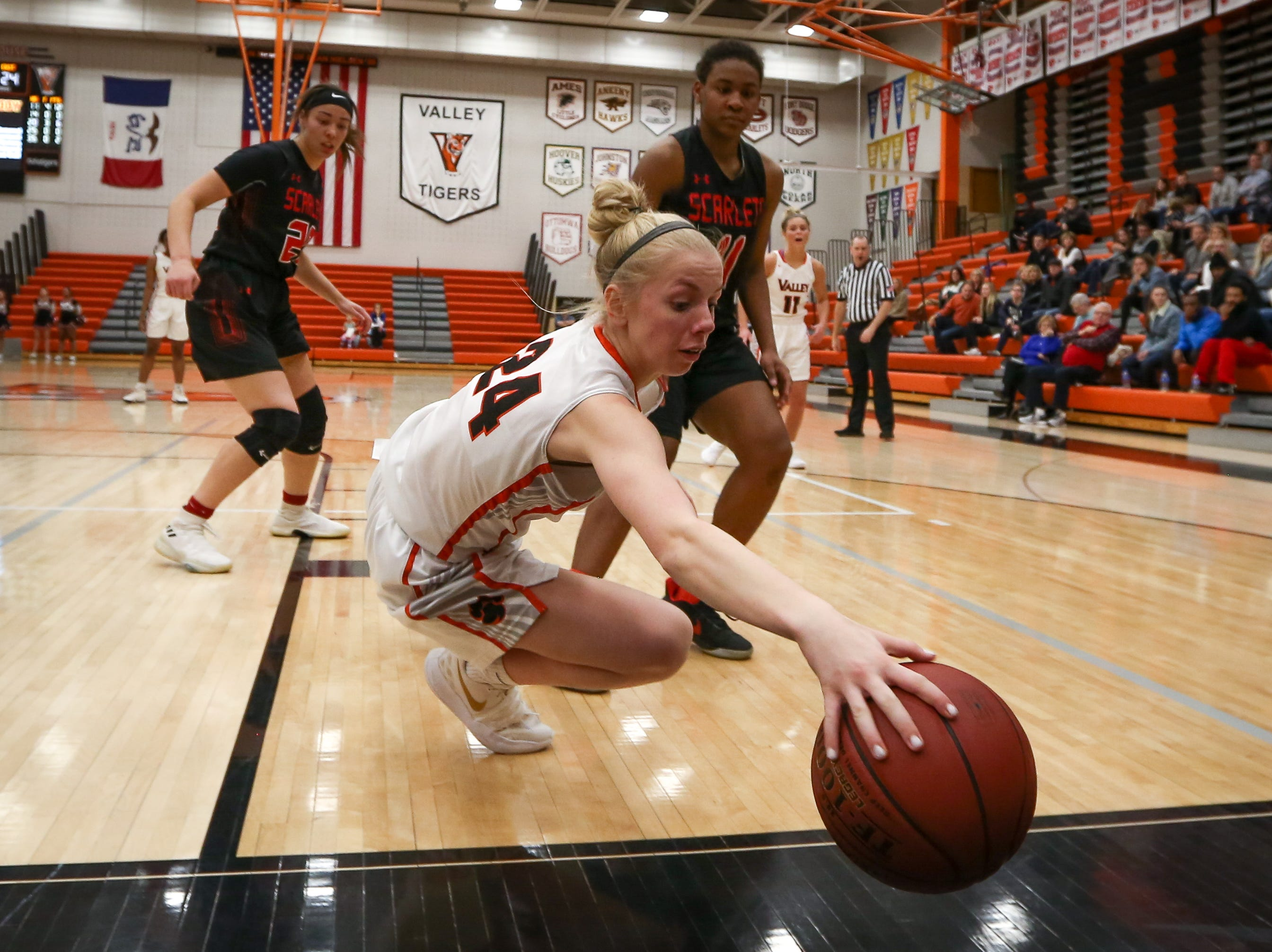Valley freshman Meredith Rieker dives for the ball during a girls high school basketball game between the East Scarlets and the Valley Tigers at Coldiron Fieldhouse at Valley High School on Jan. 8, 2019 in West Des Moines, Iowa.