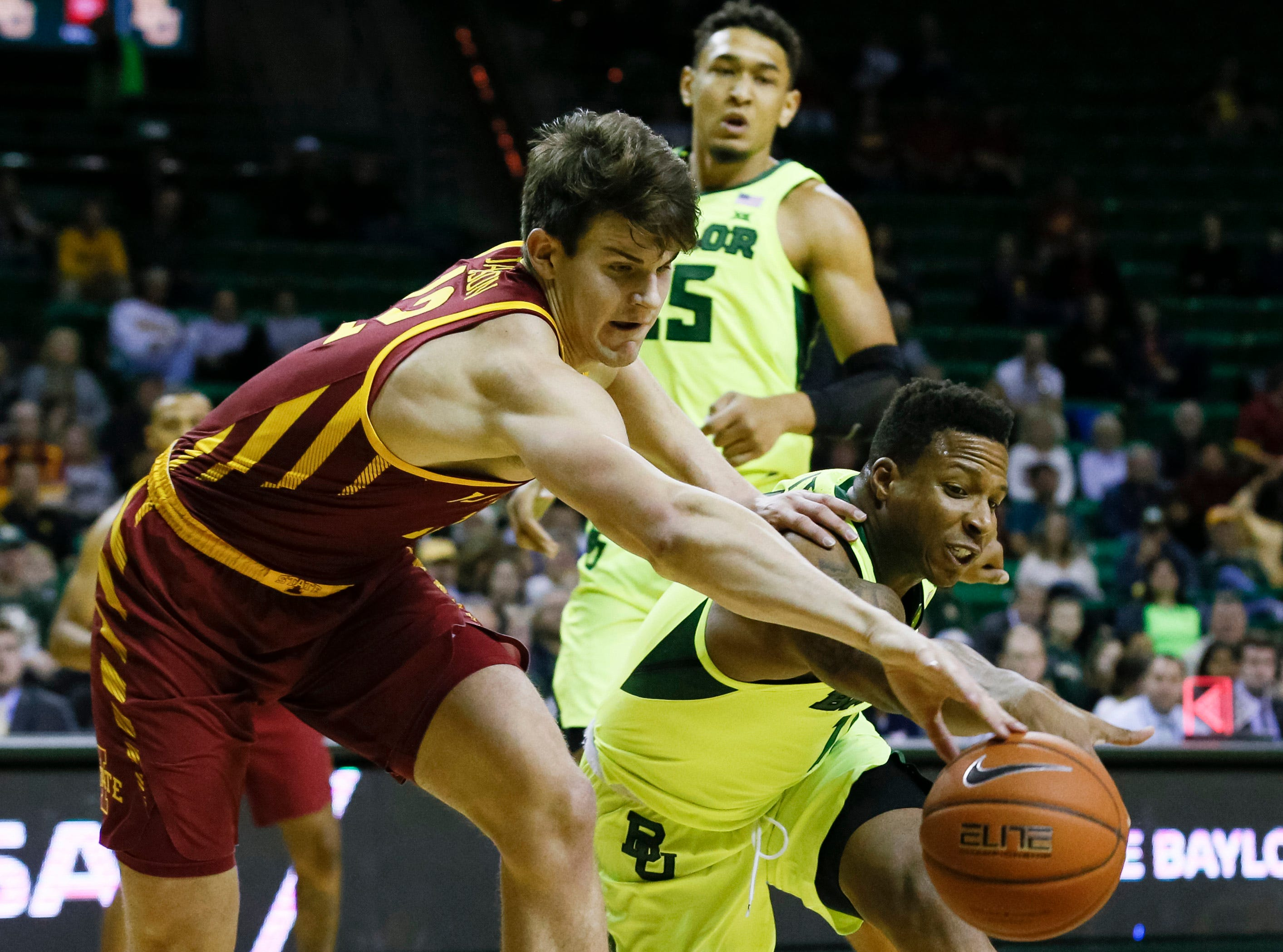 Iowa State Cyclones forward Michael Jacobson (left) and Baylor Bears guard Mark Vital (right) battle for a loose ball during the first half at Ferrell Center.