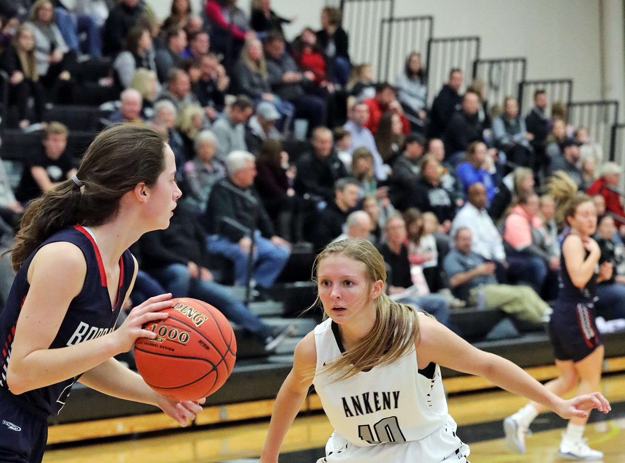 Ankeny Centennial senior Lily King applies the full-court pressure as the Marshalltown Bobcats compete against the Ankeny Centennial Jaguars in high school girls basketball on Tuesday, Jan. 8, 2019 at Ankeny Centennial High School.