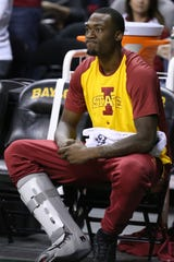 Cameron Lard sits on the bench after suffering am injury during the first half of Iowa State's game against Baylor on Tuesday, Jan. 8, 2019, in Waco, Texas.