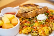 Fiesta chili chorizo scramble w fresh fruit and multigrain toast from Main Street Cafe & Bakery at 801 Grand Ave. in the skywalk Wednesday, Jan. 9, 2019.