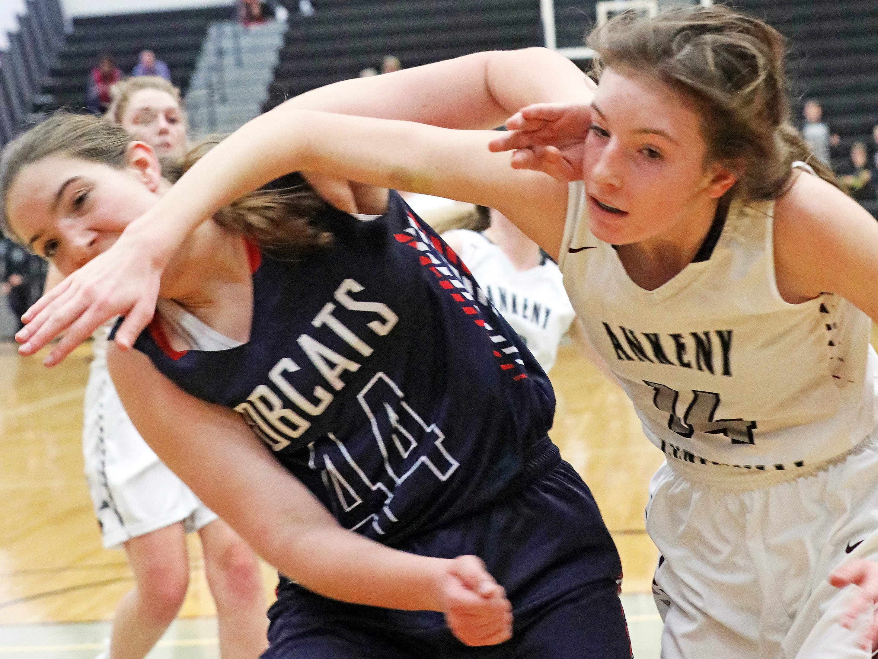 Marshalltown freshman Paige Wertzberger and Ankeny Centennial freshman Elle Street battle as the Marshalltown Bobcats compete against the Ankeny Centennial Jaguars in high school girls basketball on Tuesday, Jan. 8, 2019 at Ankeny Centennial High School.