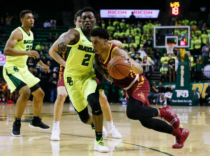 Iowa State Cyclones guard Lindell Wigginton (5) drives against Baylor Bears guard Devonte Bandoo (2) during the first half at Ferrell Center.