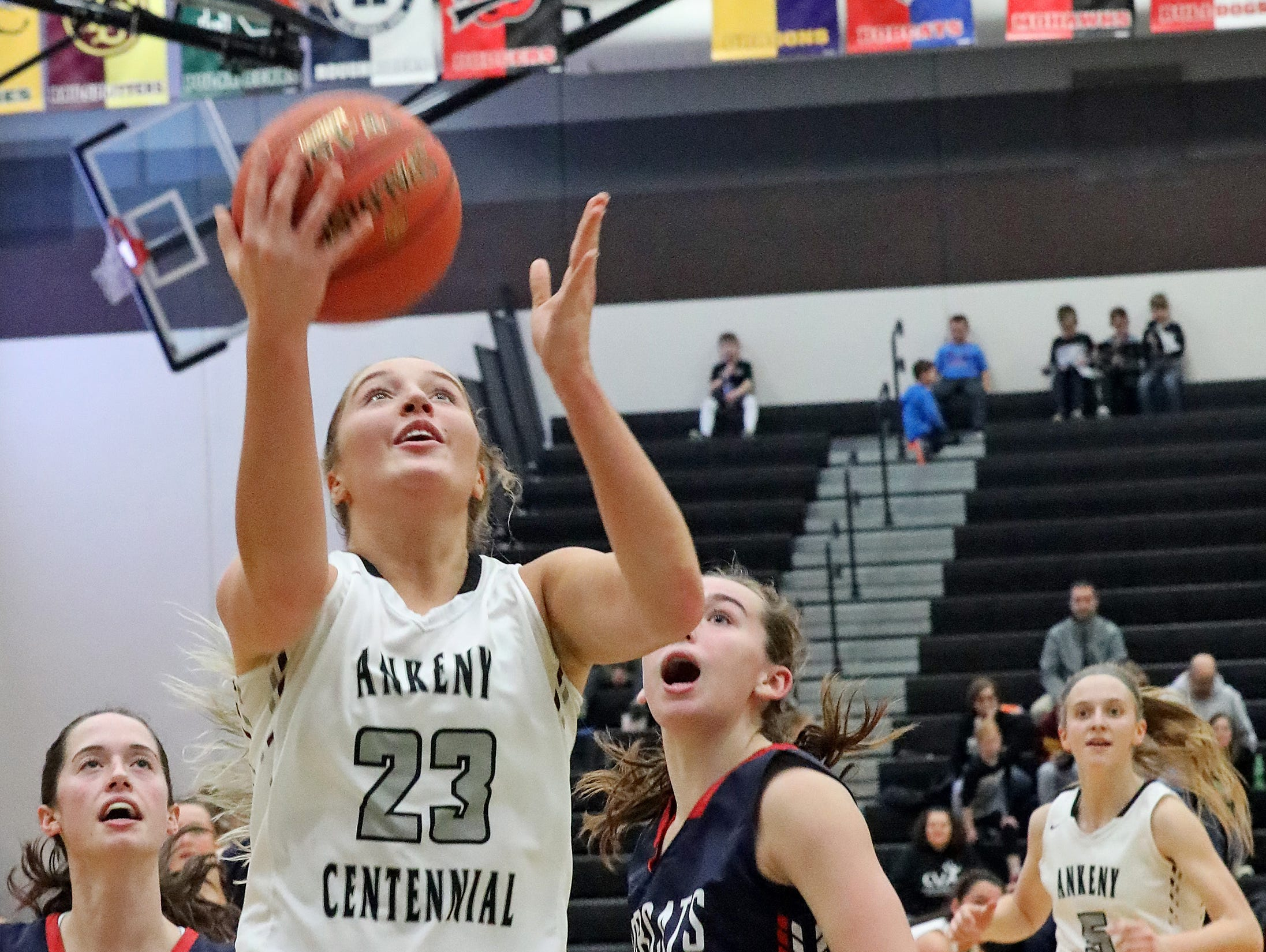Ankeny Centennial senior Kenna Sauer attempts a lat-up as the Marshalltown Bobcats compete against the Ankeny Centennial Jaguars in high school girls basketball on Tuesday, Jan. 8, 2019 at Ankeny Centennial High School.