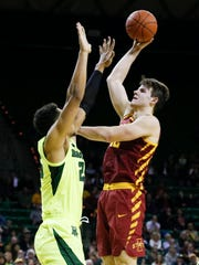 Iowa State Cyclones forward Michael Jacobson (12) shoots over Baylor Bears forward Tristan Clark (25) during the first half at Ferrell Center.