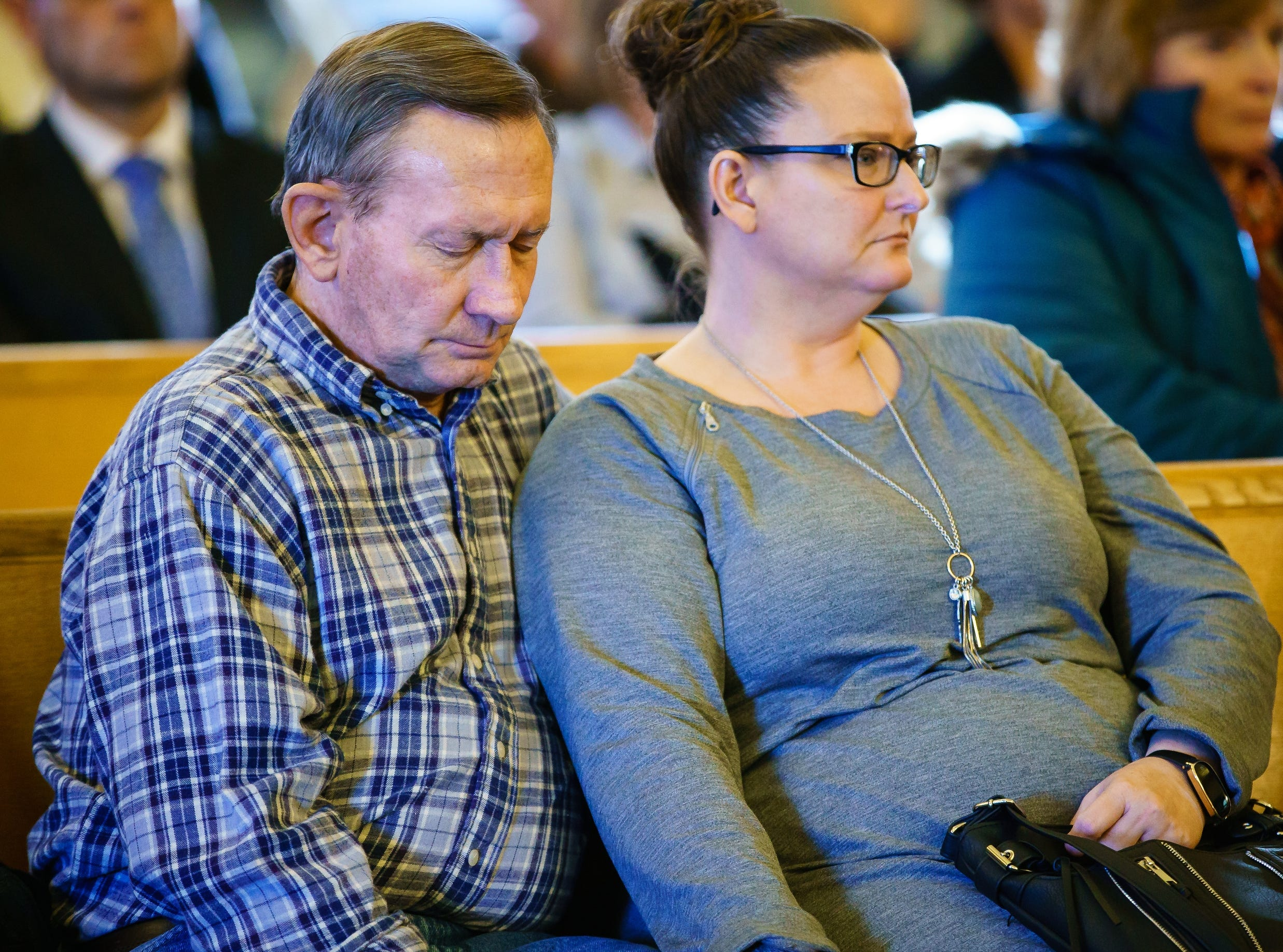 Sabrina Ray's biological Aunt, Nicole and Uncle, Pat, listen as Misty Ray pleas guilty to three counts of kidnapping during a hearing at the Dallas County Courthouse on Wednesday, Jan. 9, 2019, in Adel.