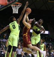 Baylor forward Flo Thamba, left, blocks the shot of Iowa State forward Michael Jacobson, center, as guard Mario Kegler, right, helps defend during the first half of an NCAA college basketball game Tuesday, Jan. 8, 2019, in Waco, Texas.
