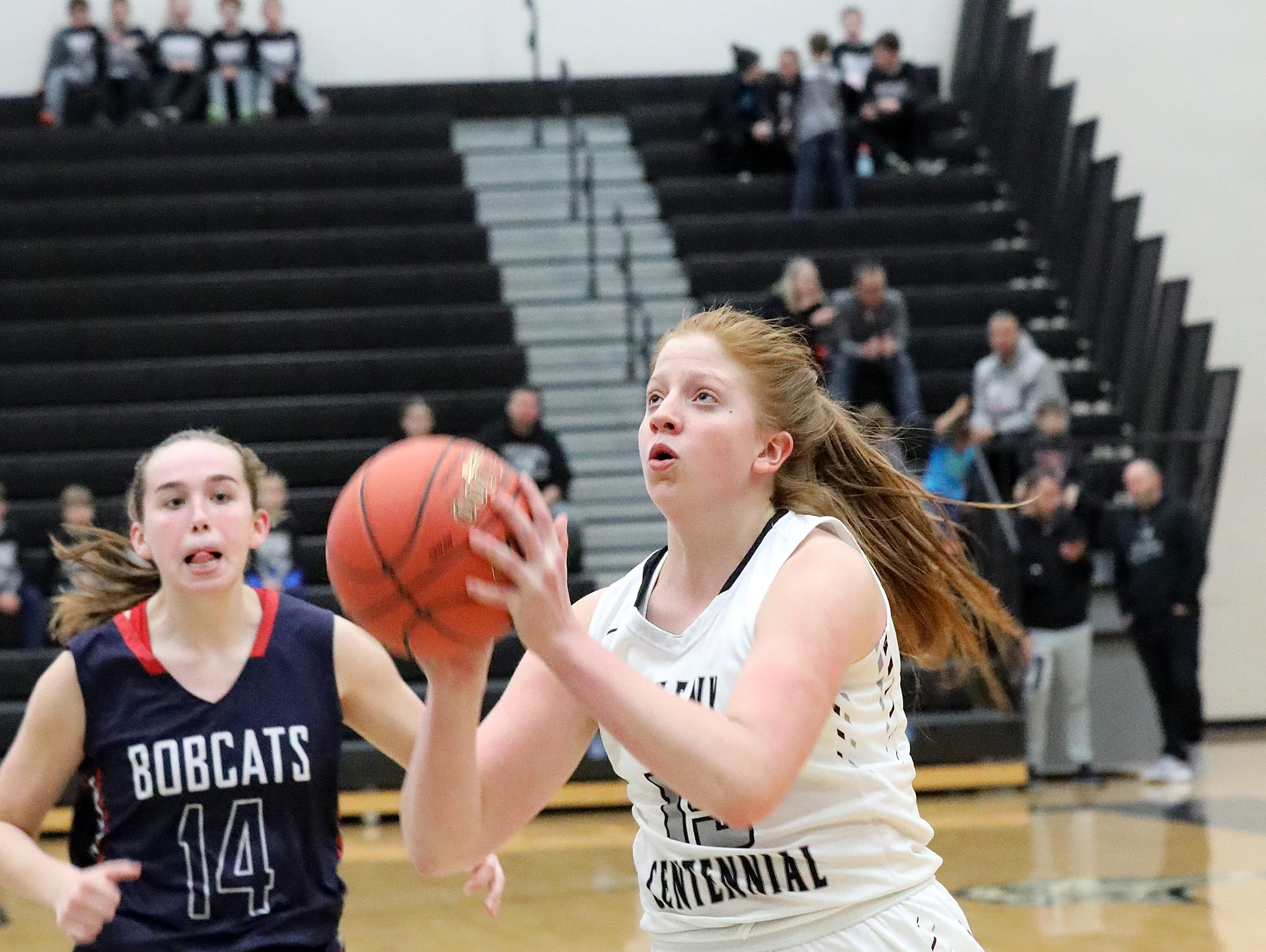 Ankeny Centennial sophomore Jackie Pippett tries a lay-up as the Marshalltown Bobcats compete against the Ankeny Centennial Jaguars in high school girls basketball on Tuesday, Jan. 8, 2019 at Ankeny Centennial High School.