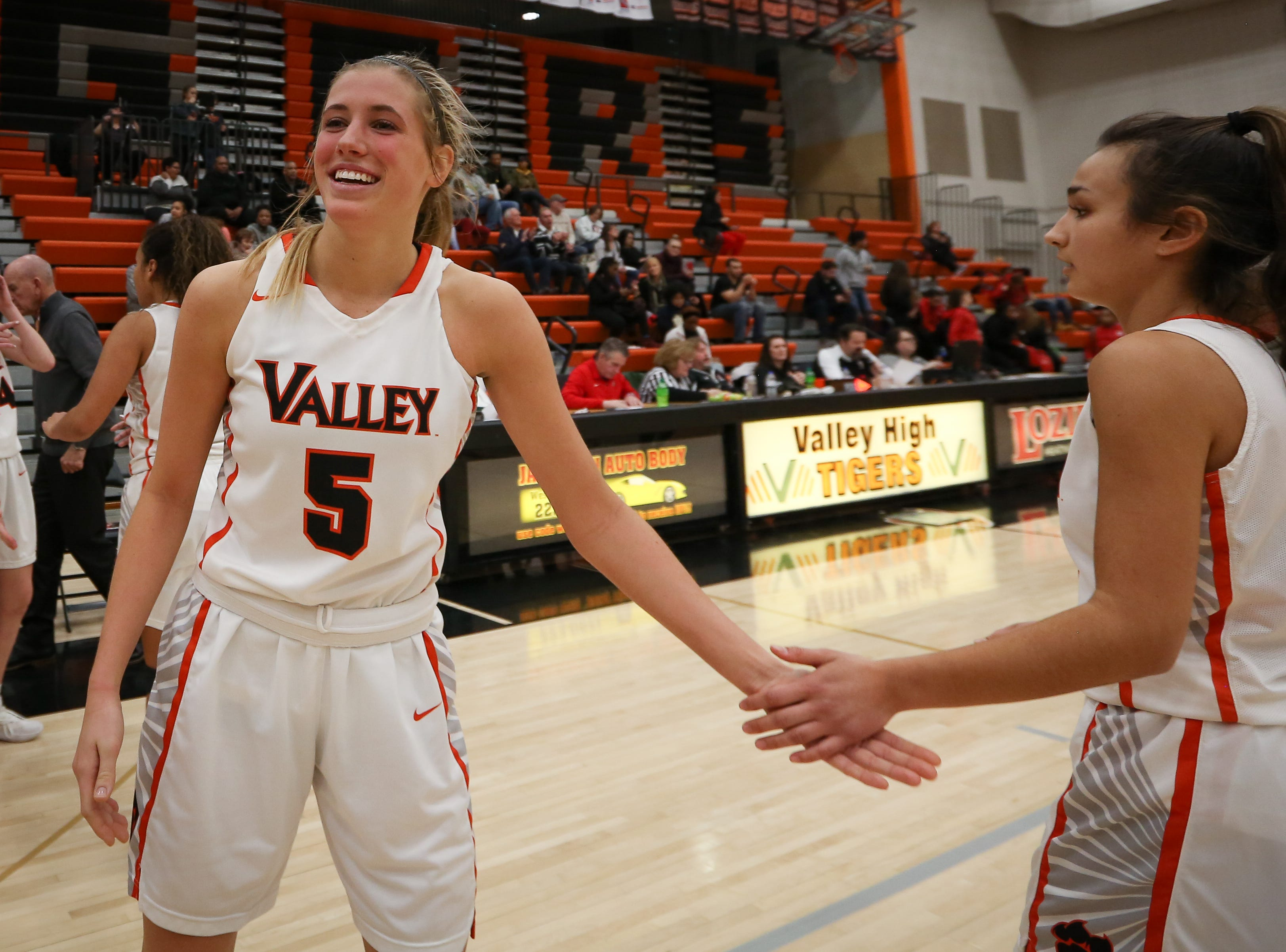 Valley junior Grace Plummer celebrates with sophomore Anna Bernhard after the Tigers defeated the East Scarlets, 67-46, in a girls high school basketball game at Coldiron Fieldhouse at Valley High School on Jan. 8, 2019 in West Des Moines, Iowa.