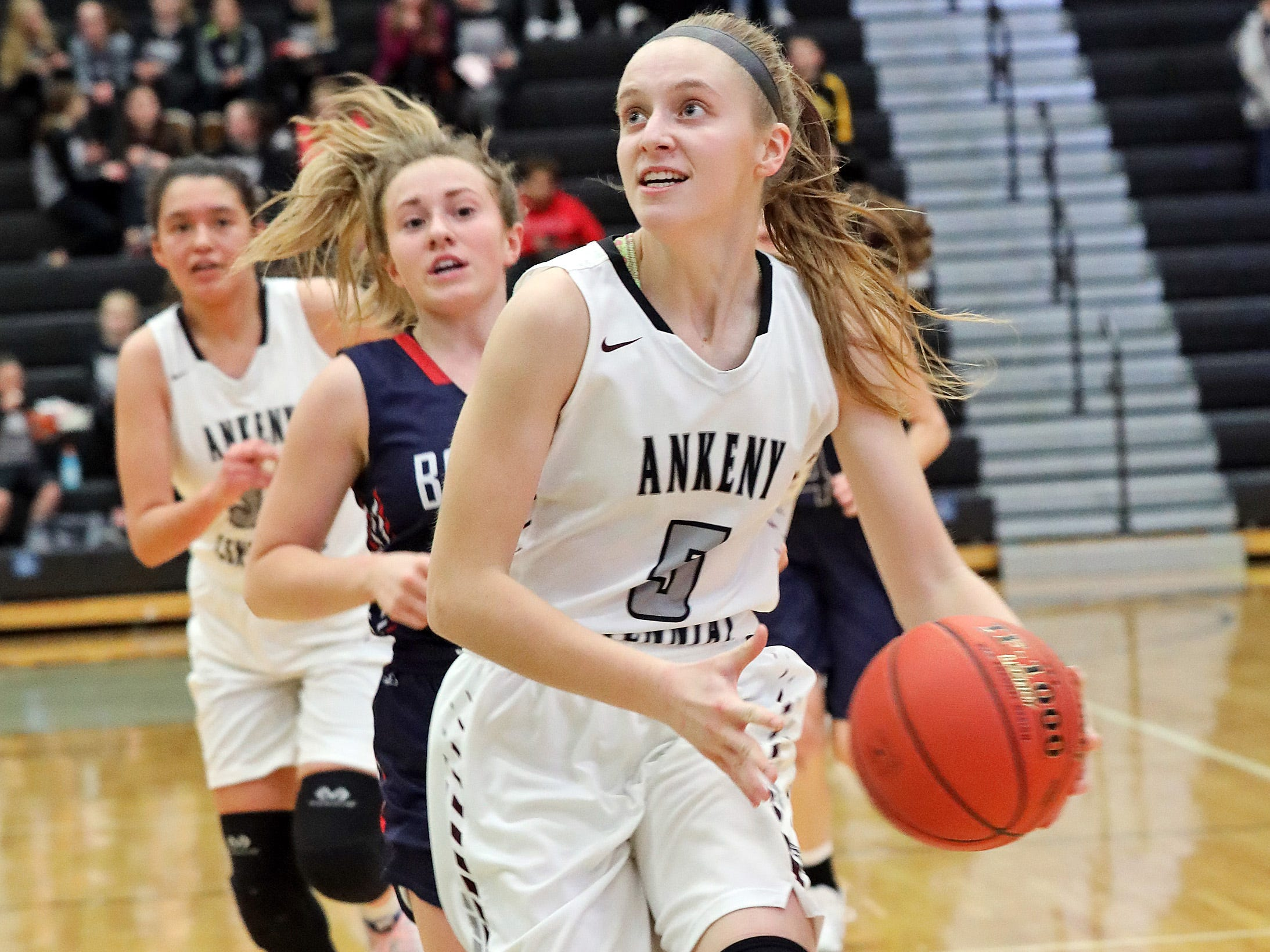 Ankeny Centennial junior Taylor Runchey heads for a lay-up as the Marshalltown Bobcats compete against the Ankeny Centennial Jaguars in high school girls basketball on Tuesday, Jan. 8, 2019 at Ankeny Centennial High School.