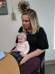Chelsey DeRuyter, chief development officer at Girl Scouts of Greater Iowa, sits with her 14-week-old daughter, Finley.