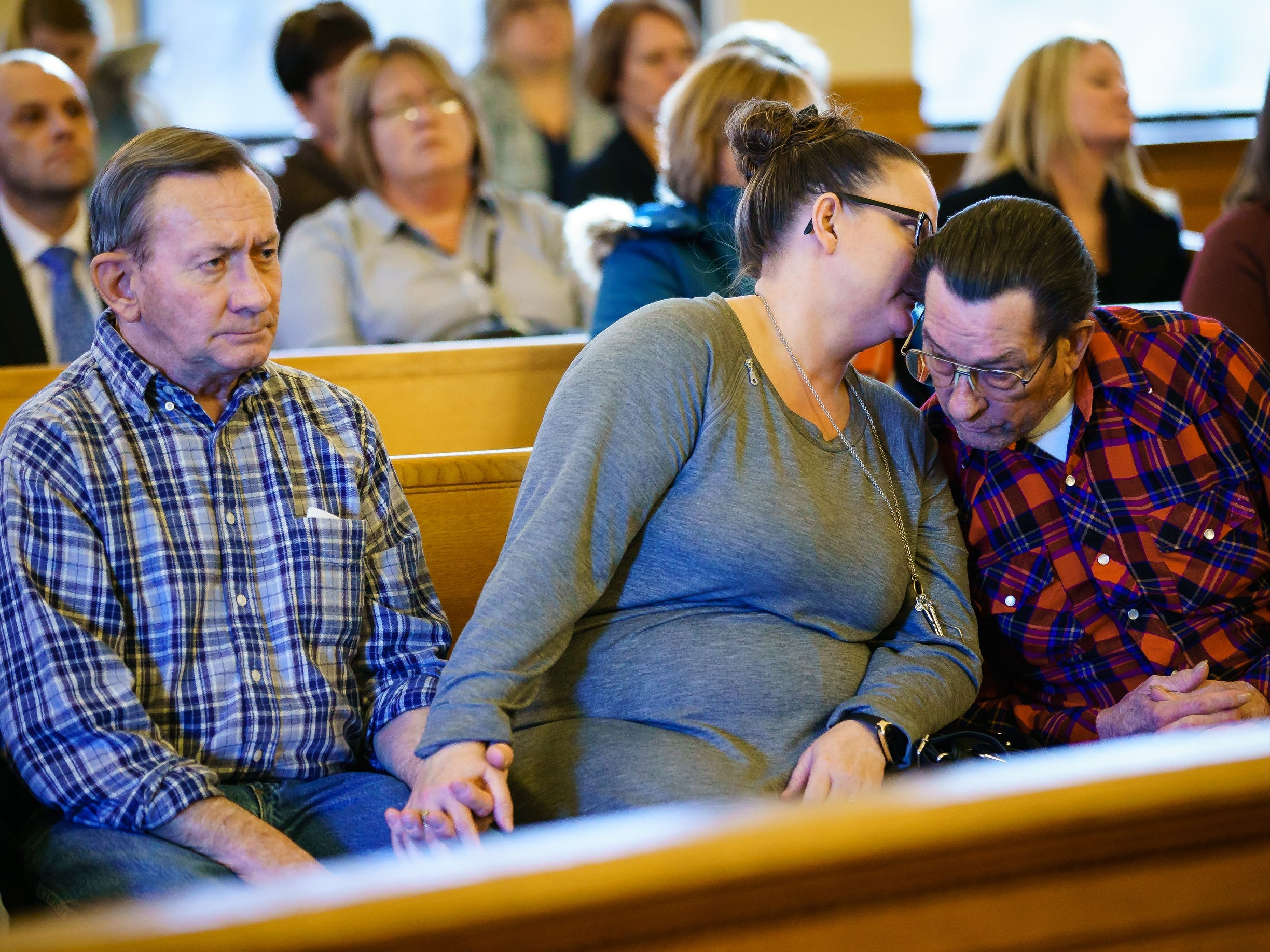 Sabrina Ray's biological Aunt, Nicole and Uncle, Pat, listen and talk to her biological grandfather Eugene Busch as Misty Ray pleas guilty to three counts of kidnapping during a hearing at the Dallas County Courthouse on Wednesday, Jan. 9, 2019, in Adel.