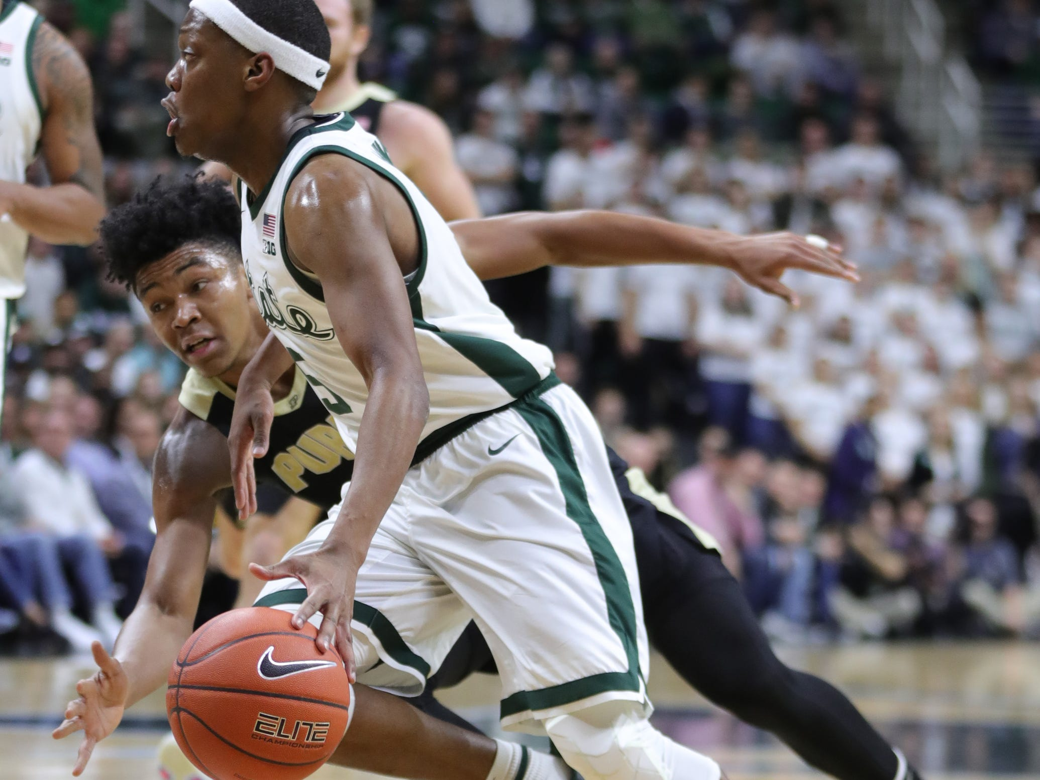 Michigan State guard Cassius Winston drives by Purdue guard Nojel Winston during first half action Tuesday, Jan. 8, 2019 at the Breslin Center in East Lansing, Mich.