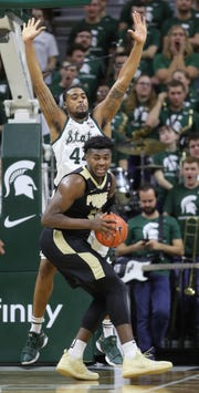 Michigan State forward Nick Ward defends against Purdue forward Trevion Williams during second half action Tuesday, Jan. 8, 2019 at the Breslin Center in East Lansing, Mich.