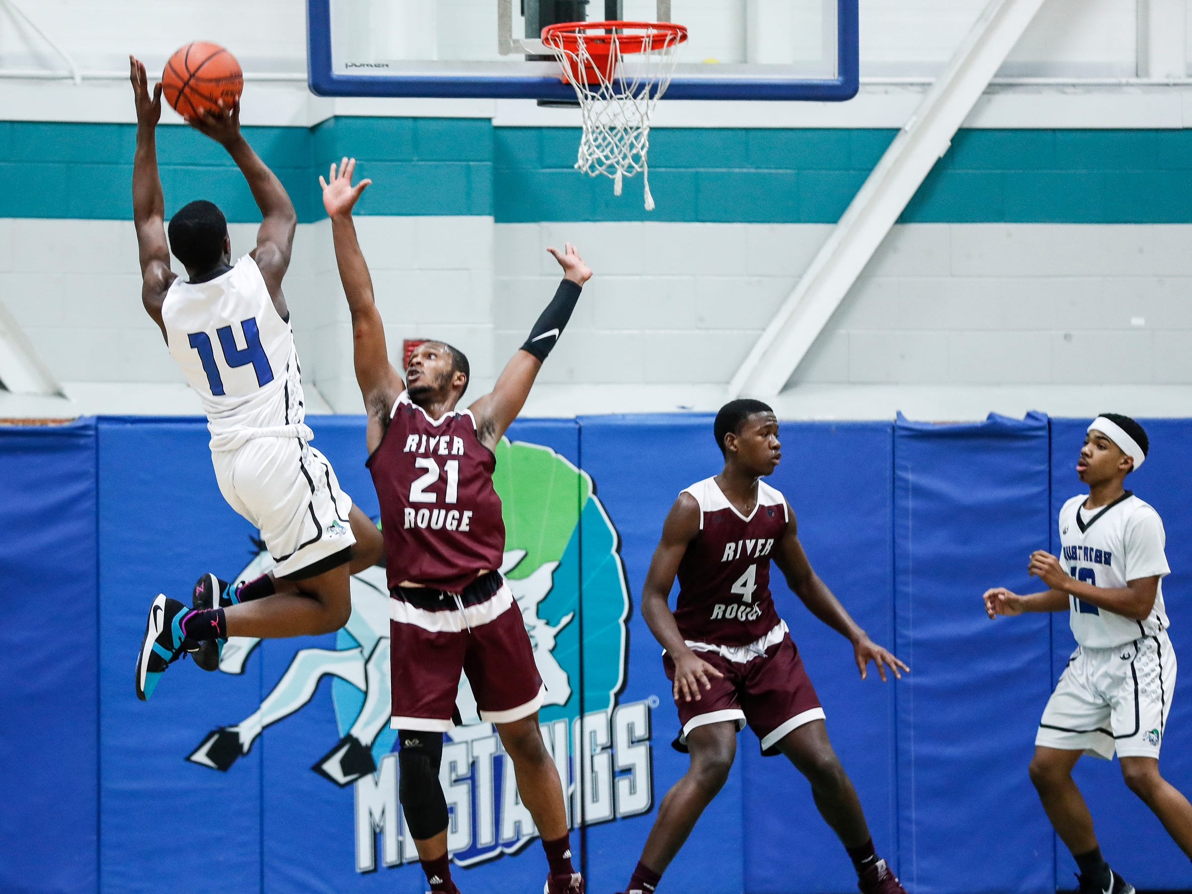 Henry Ford Academy: School for Creative Studies Malik Smith (14) shoots against River Rouge Nigel Colvin (21) during first half at the A. Alfred Taubman Center For Design Education in Detroit, Tuesday, Jan. 8, 2019.