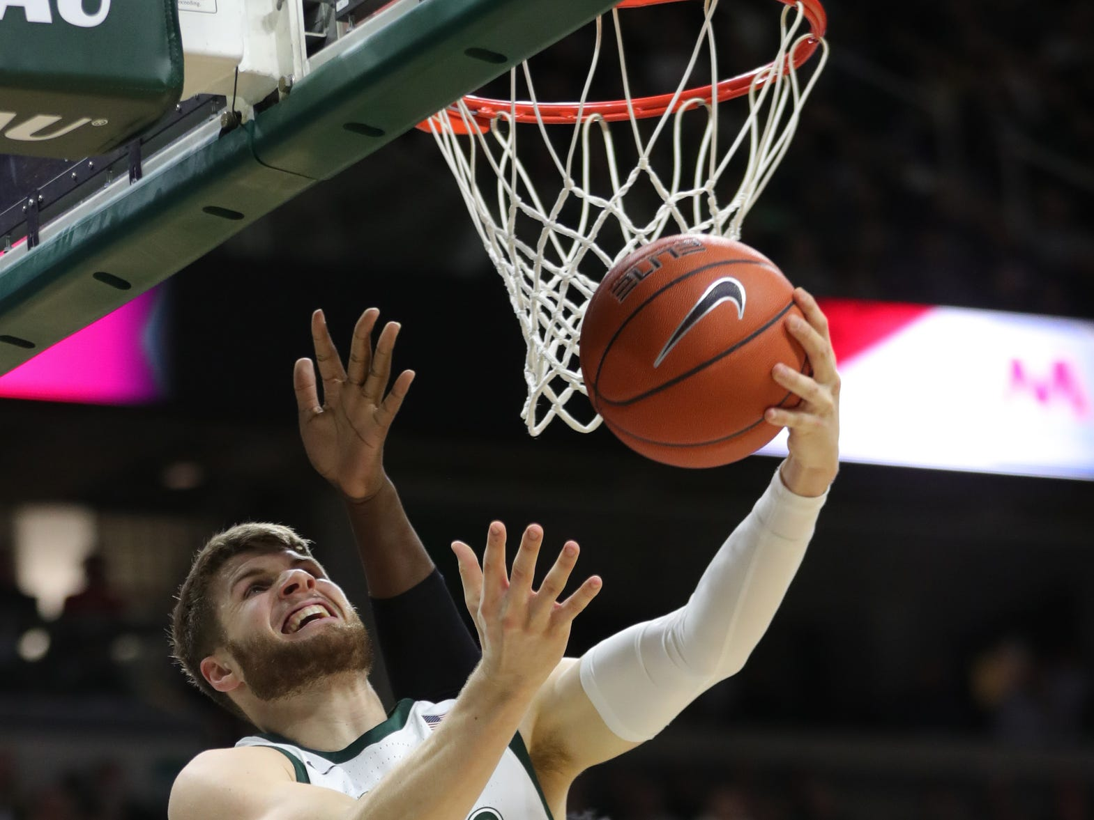 Michigan State guard Kyle Ahrens scores against Purdue forward Trevion Williams during first half action Tuesday, Jan. 8, 2019 at the Breslin Center in East Lansing, Mich.
