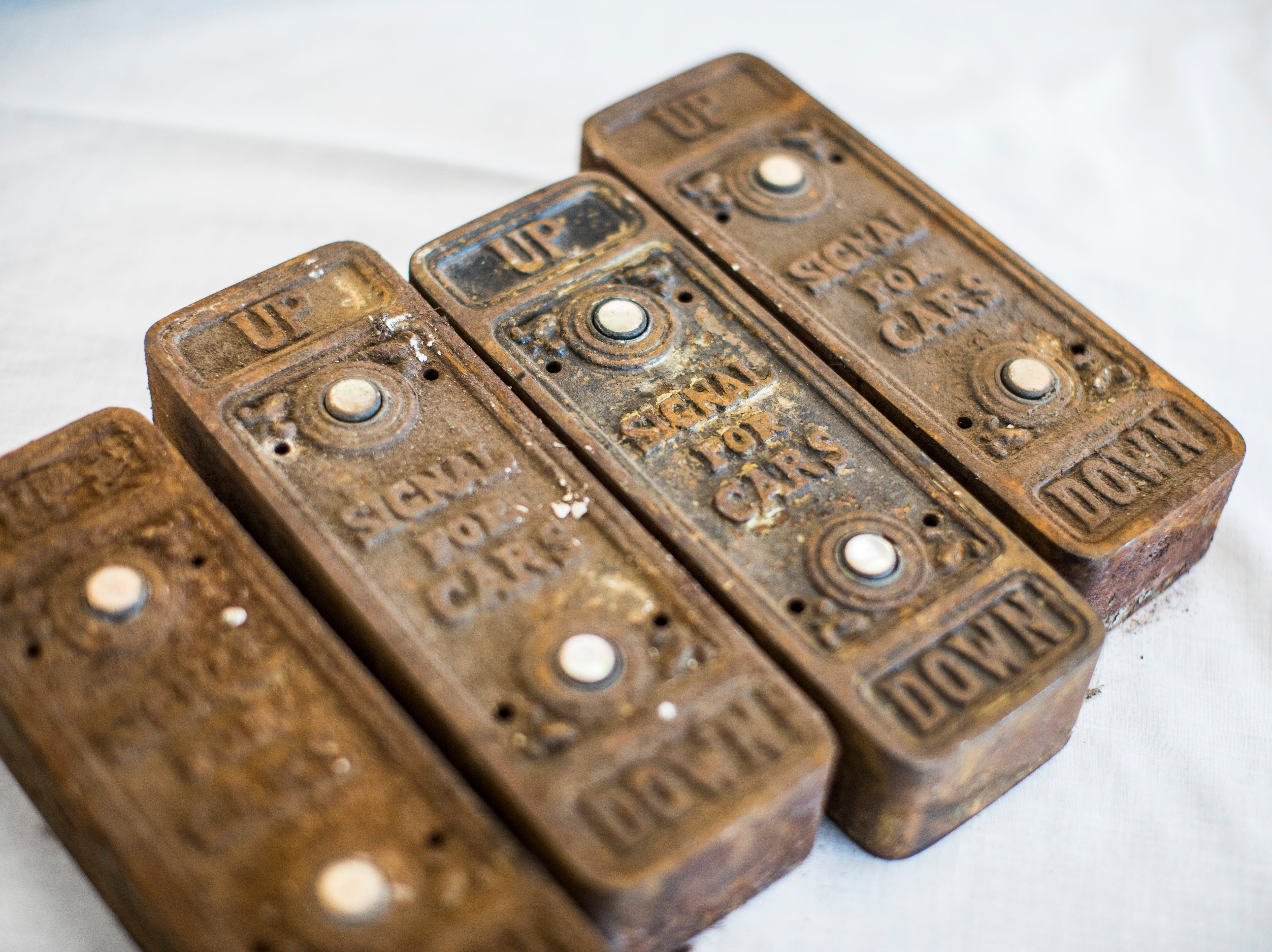 Cast iron elevator buttons have been returned to Michigan Central Station.
