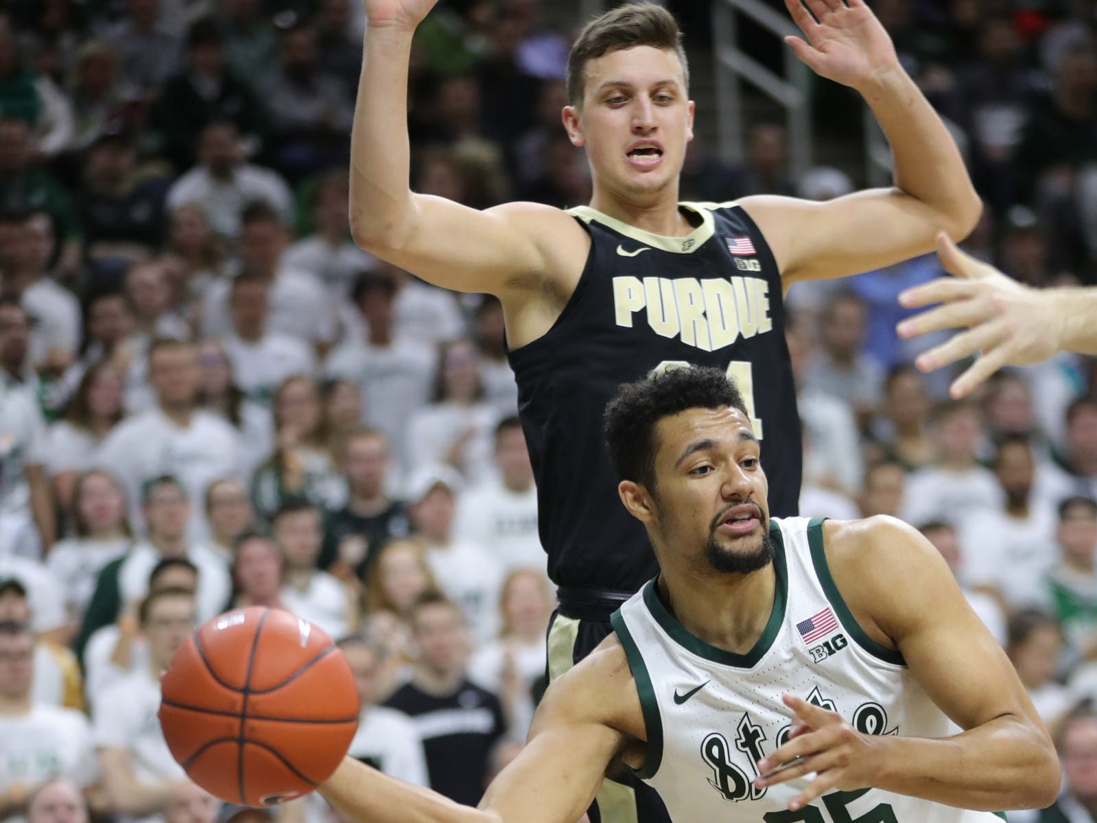 Michigan State forward Kenny Goins drives by Purdue forward Grady Eifert during first half action Tuesday, September 8, 2019 at the Breslin Center in East Lansing, Mich.