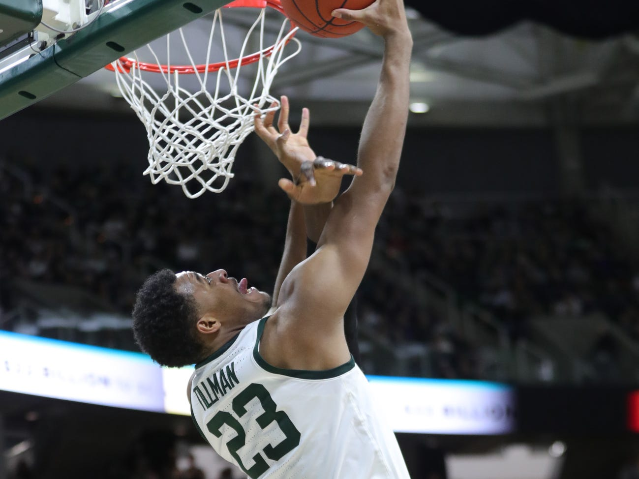 Michigan State forward Xavier Tillman scores against Purdue forward Trevion Williams during second half action Tuesday, Jan. 8, 2019 at the Breslin Center in East Lansing, Mich.