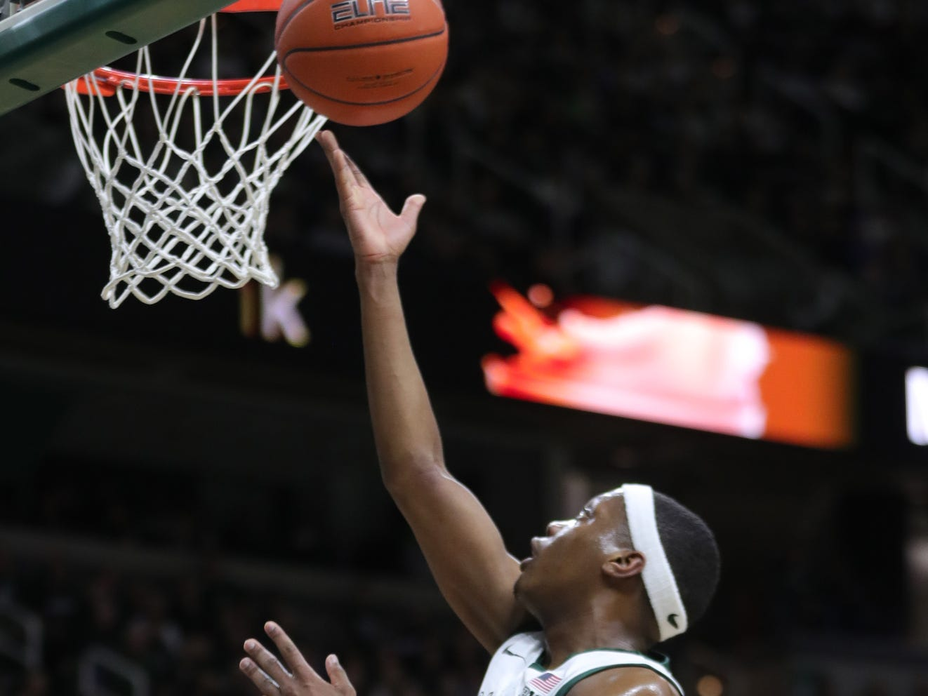 Michigan State guard Cassius Winston scores against Purdue guard Nojel Winston during first half action Tuesday, Jan. 8, 2019 at the Breslin Center in East Lansing, Mich.