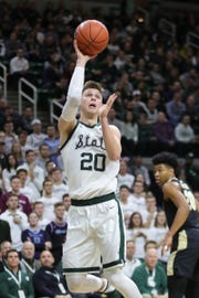 Michigan State guard Matt McQuaid scores against Purdue  during first half action Tuesday, Jan. 8, 2019 at the Breslin Center in East Lansing, Mich.