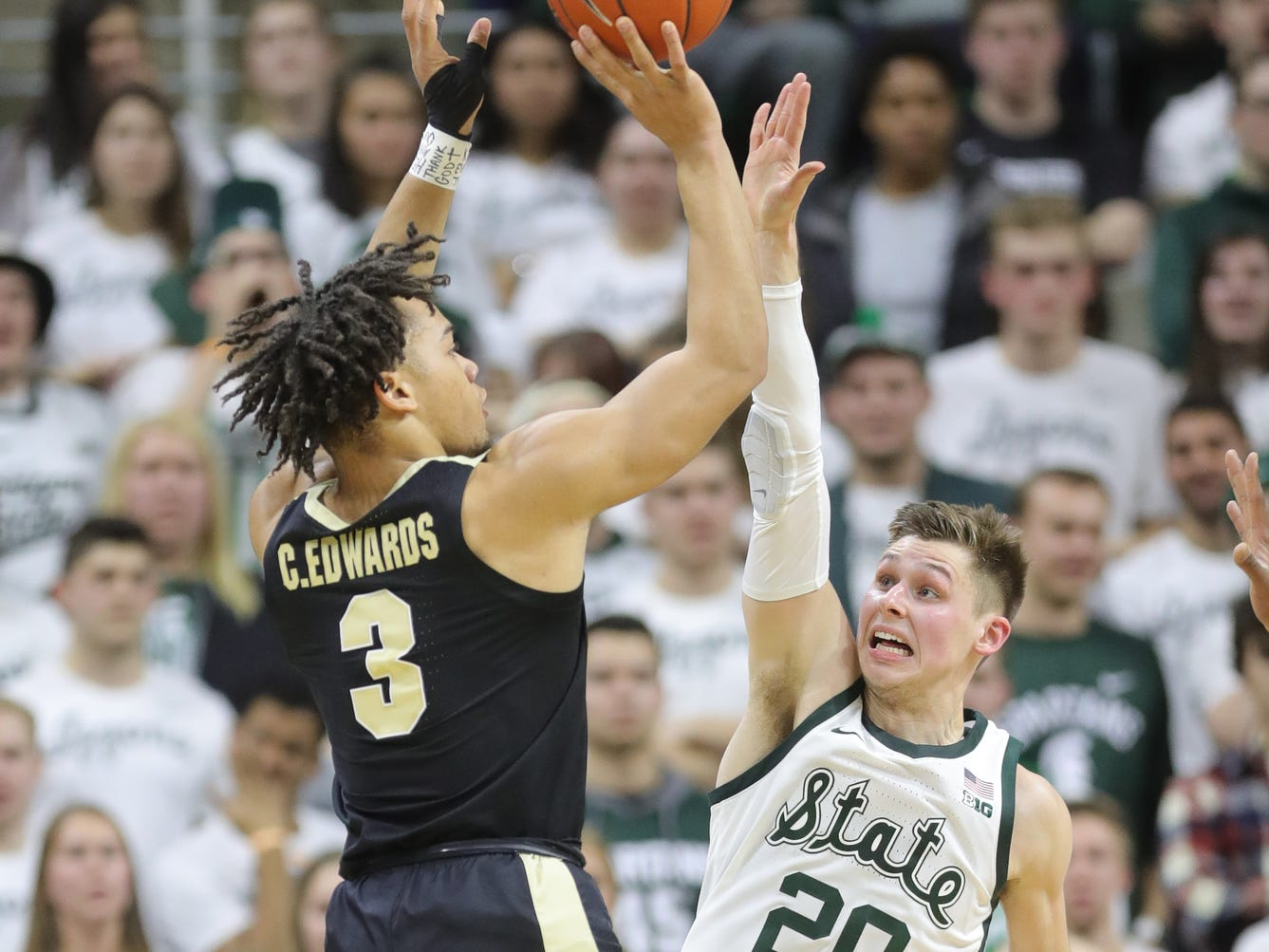 Michigan State guard Matt McQuaid defends against Purdue guard Carsen Edwards during first half action Tuesday, Jan. 8, 2019 at the Breslin Center in East Lansing, Mich.