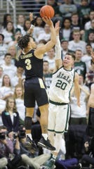 Michigan State guard Matt McQuaid defends Purdue guard Carsen Edwards, Jan. 8 in East Lansing.