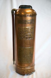 A fire extinguisher that has been returned to Michigan Central Station.