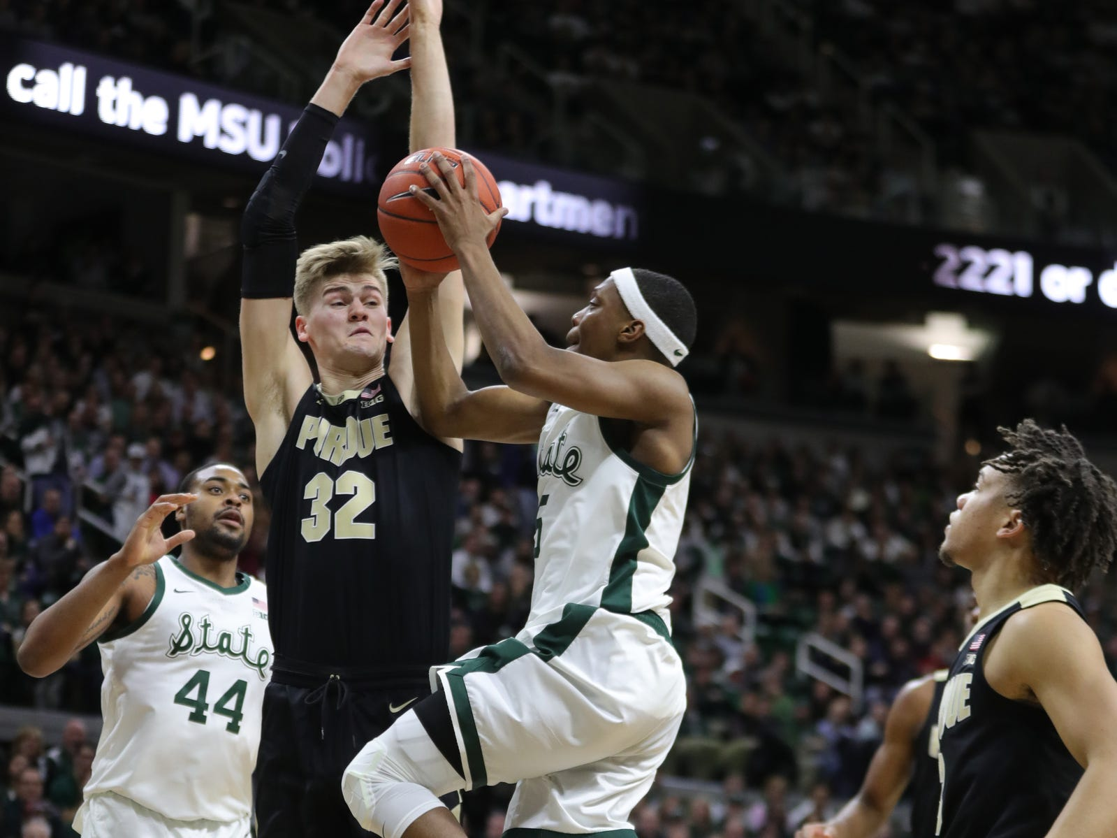 Michigan State guard Cassius Winston scores against Purdue center Matt Haarms during first half action Tuesday, September 8, 2019 at the Breslin Center in East Lansing, Mich.