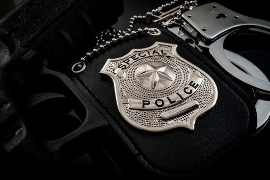 Police Badge Handcuffs And Gun