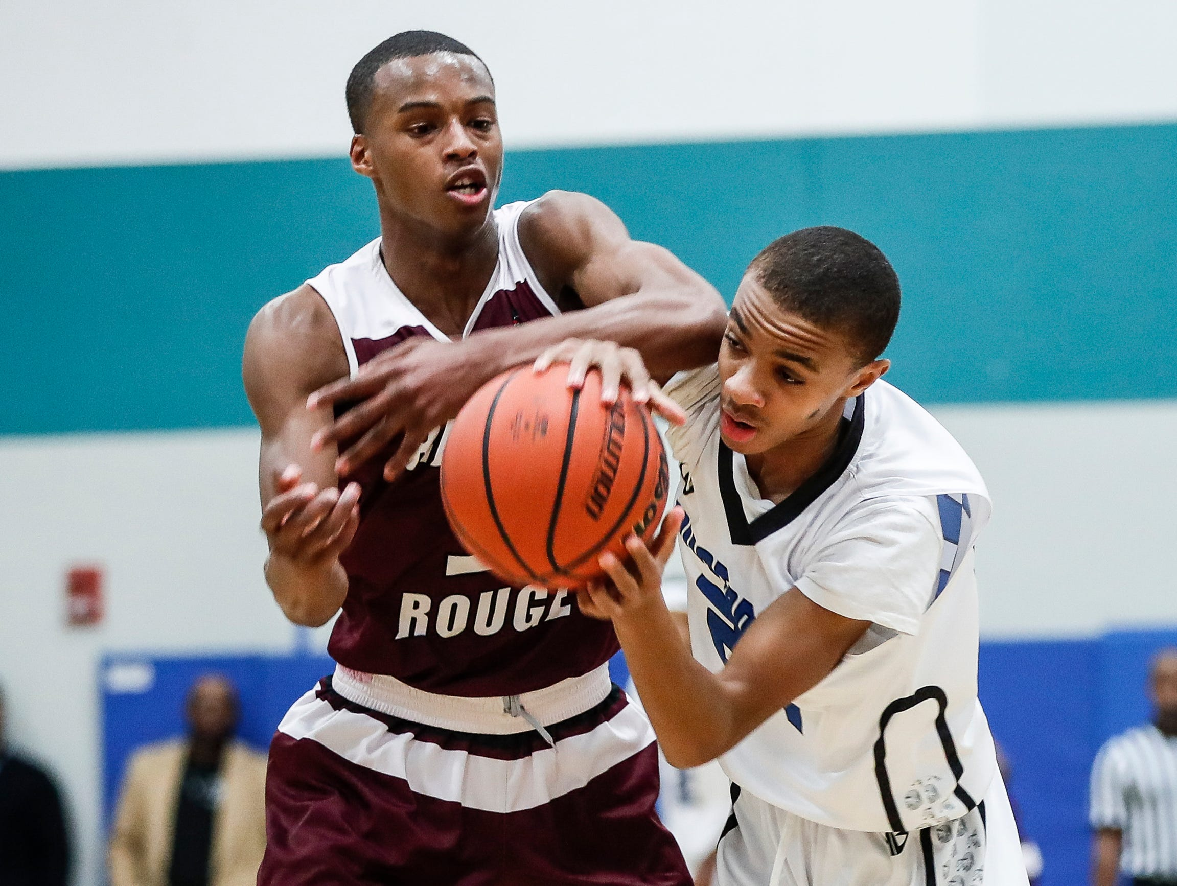 River Rouge's Micah Parrish (3) and Henry Ford Academy: School for Creative Studies' Omarion Burgess (21) battle for the ball during second half at the A. Alfred Taubman Center For Design Education in Detroit, Tuesday, Jan. 8, 2019.