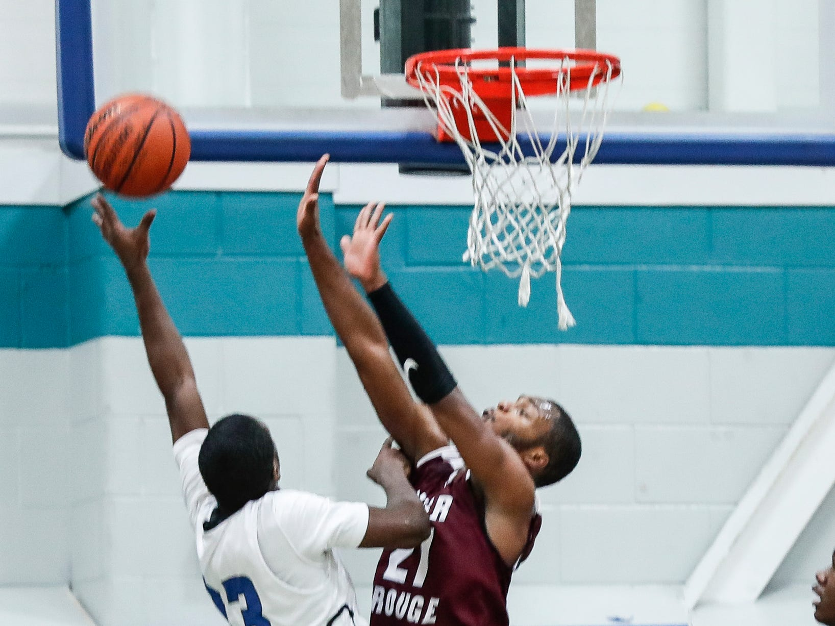 River Rouge Nigel Colvin (21) tries to block a layup by Henry Ford Academy: School for Creative Studies Joshua Wilson (13) during first half at the A. Alfred Taubman Center For Design Education in Detroit, Tuesday, Jan. 8, 2019.
