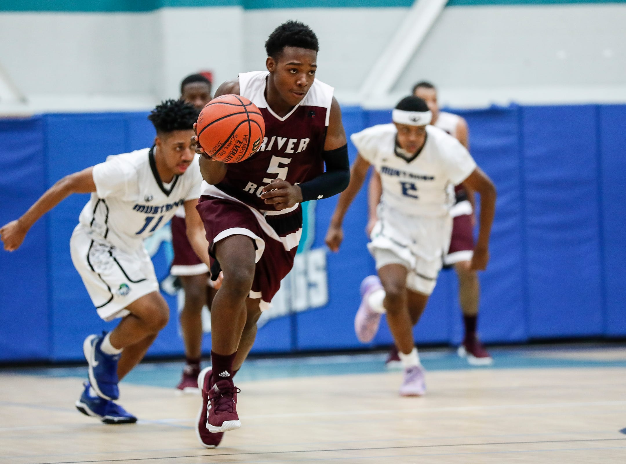 River Rouge's Jason Norton (5) dribbles against Henry Ford Academy: School for Creative Studies during first half at the A. Alfred Taubman Center For Design Education in Detroit, Tuesday, Jan. 8, 2019.