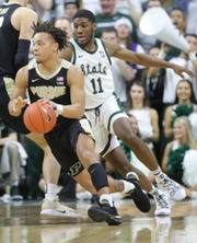 Michigan State forward Aaron Henry defends Purdue guard Carsen Edwards, Jan. 8, 2019 at the Breslin Center in East Lansing.