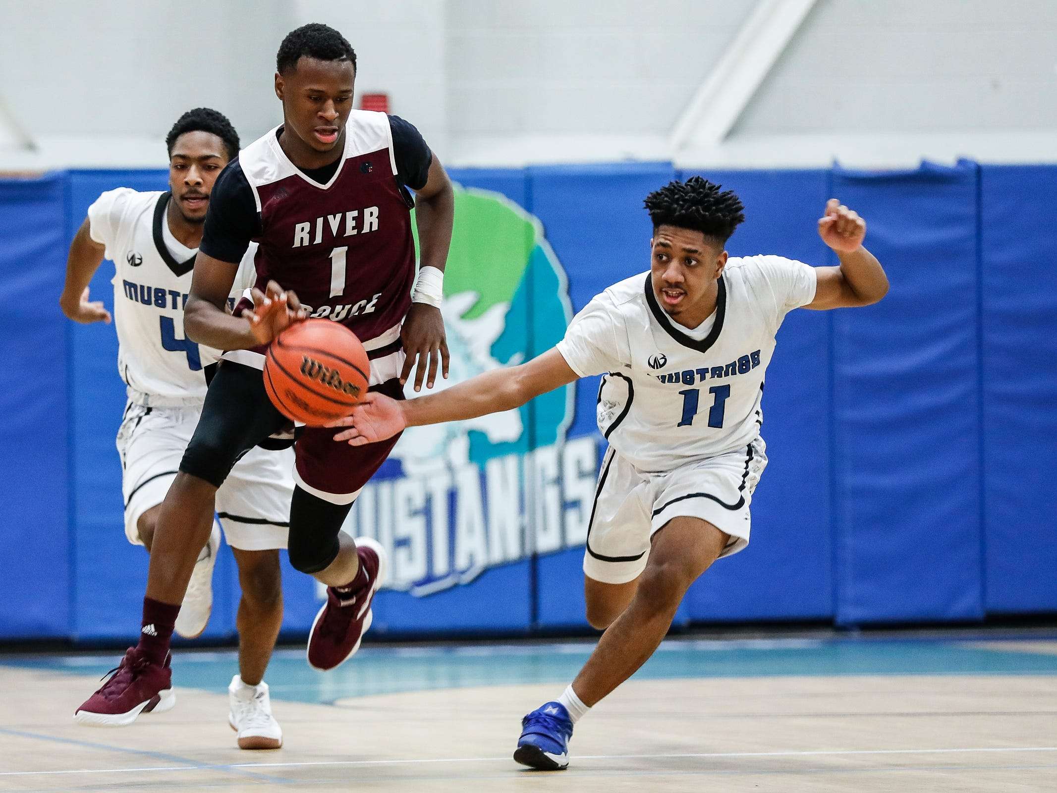 River Rouge's Donovan Freeman (1) and Henry Ford Academy: School for Creative Studies' Jabbar Martin Jr. (11) battle for the loose ball during first half at the A. Alfred Taubman Center For Design Education in Detroit, Tuesday, Jan. 8, 2019.