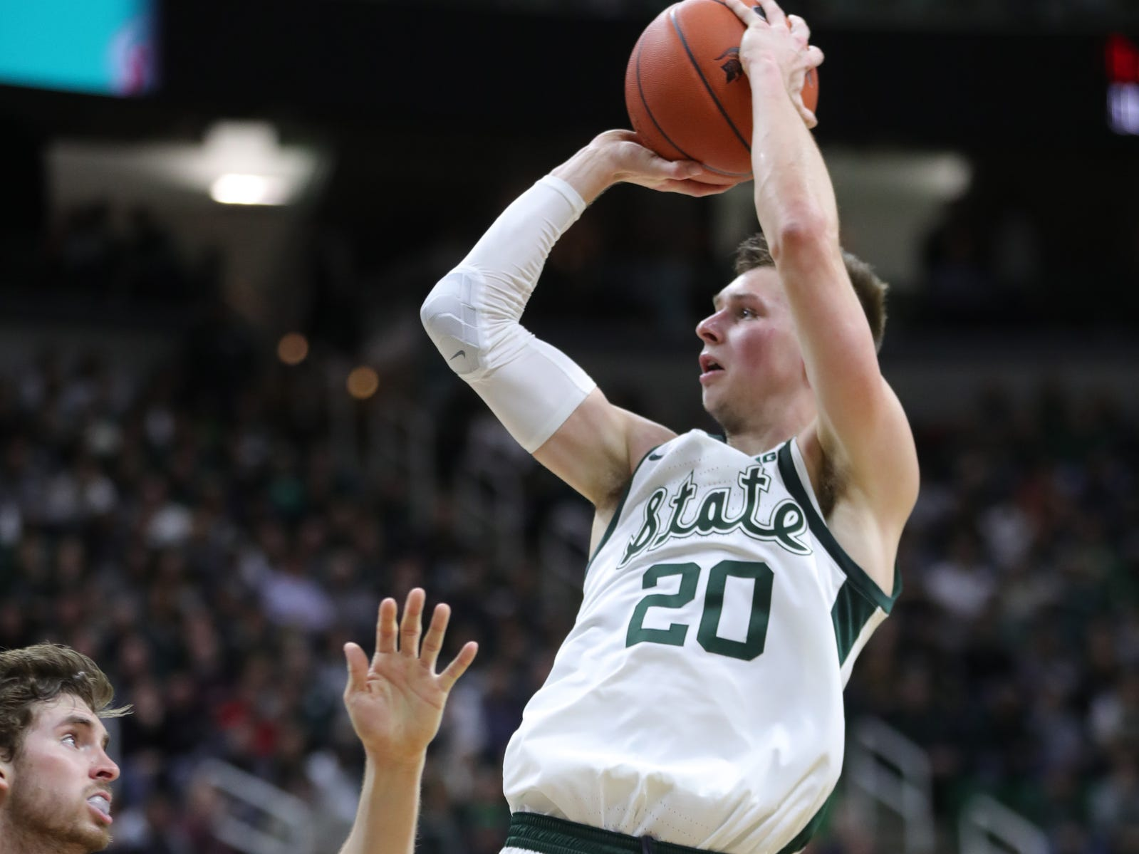 Michigan State guard Matt McQuaid scores against Purdue guard Ryan Cline during first half action Tuesday, September 8, 2019 at the Breslin Center in East Lansing, Mich.
