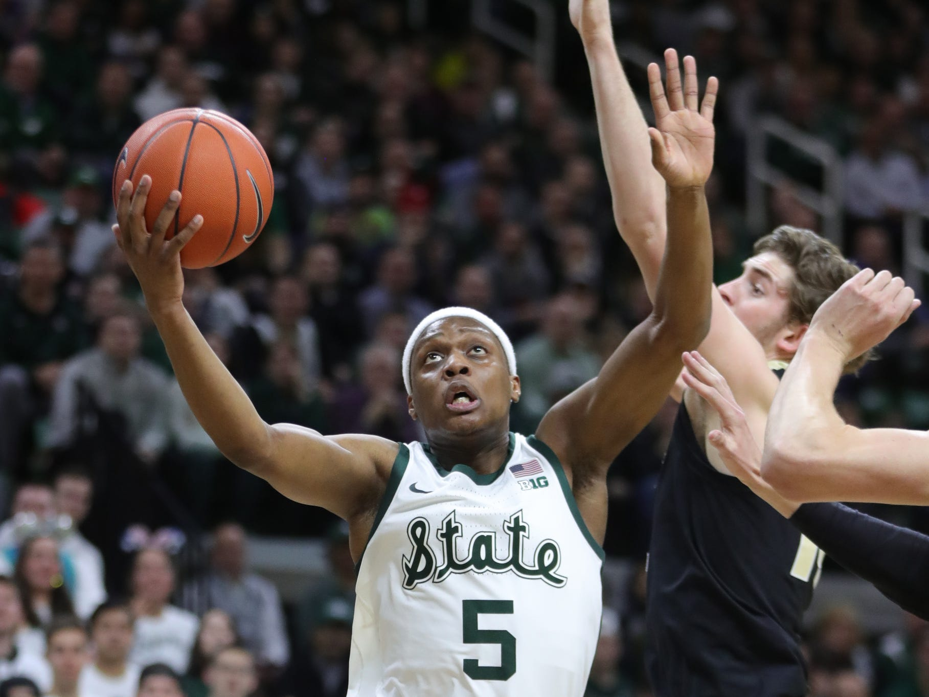 Michigan State guard Cassius Winston scores against Purdue during first half action Tuesday, Jan. 8, 2019 at the Breslin Center in East Lansing, Mich.