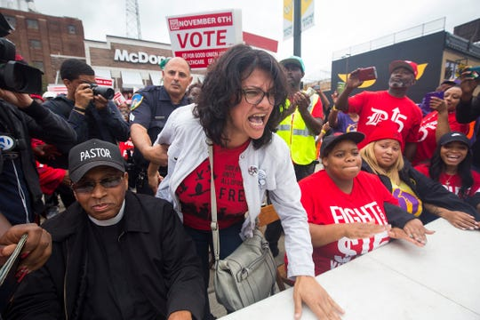 Then-congressional candidate Rashida Tlaib joins Fight For $15 and striking McDonald's employees, as she gets arrested in front of McDonald's in Detroit on Oct. 2, 2018, during a protest.